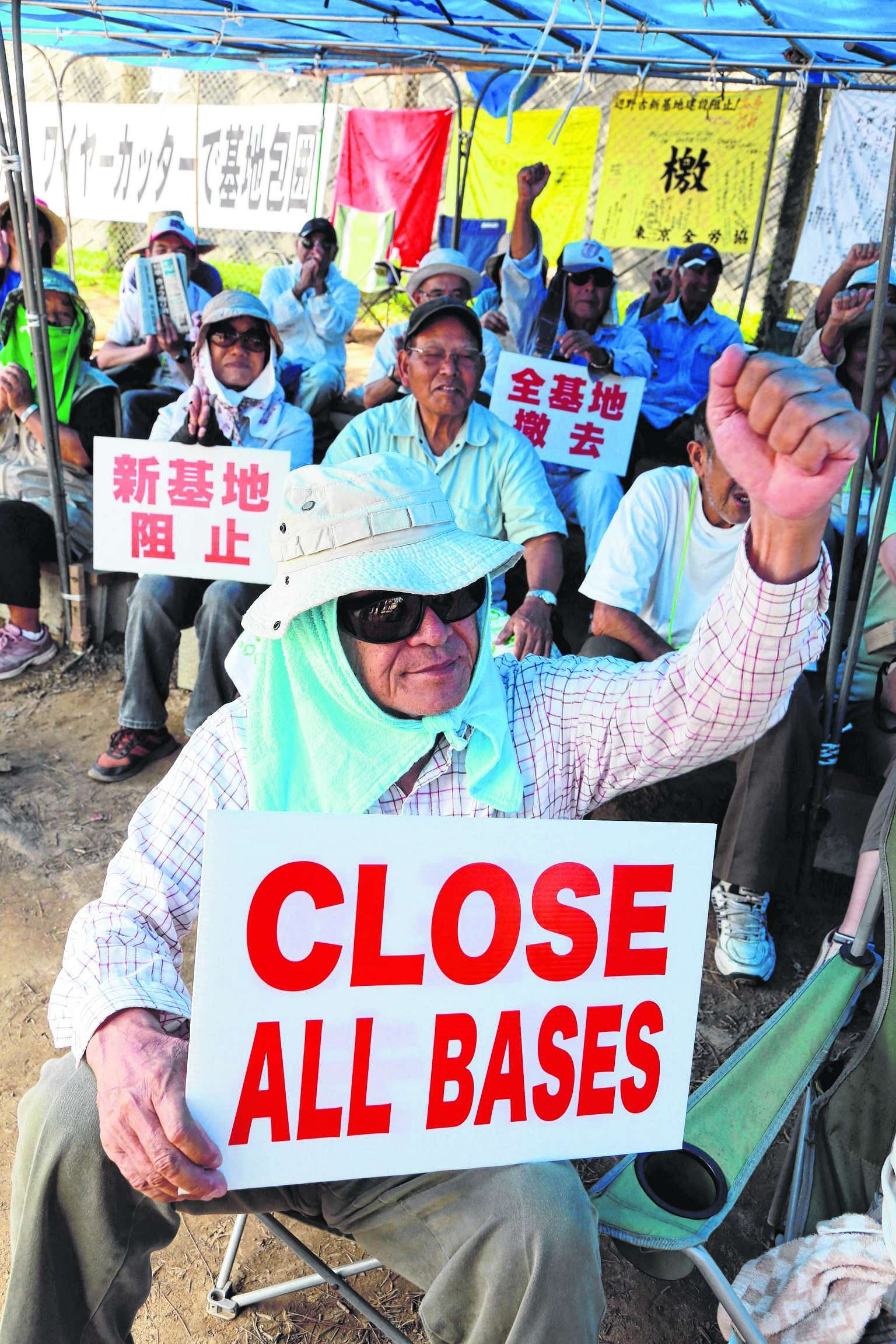 Protesters in Nago, Okinawa, making their stand yesterday against plans for a new US airbase on the southern Japanese island.