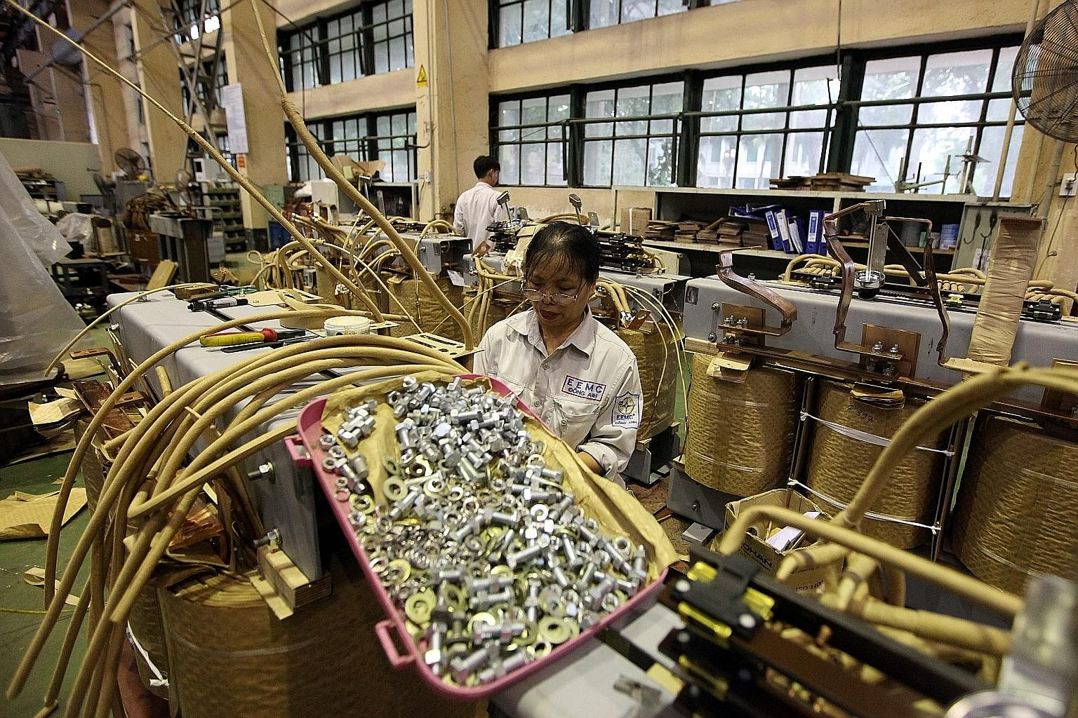 Workers in a transformer manufacturing workshop in Hanoi. Vietnam's manufacturing and export sector has traditionally focused on the US and European markets.