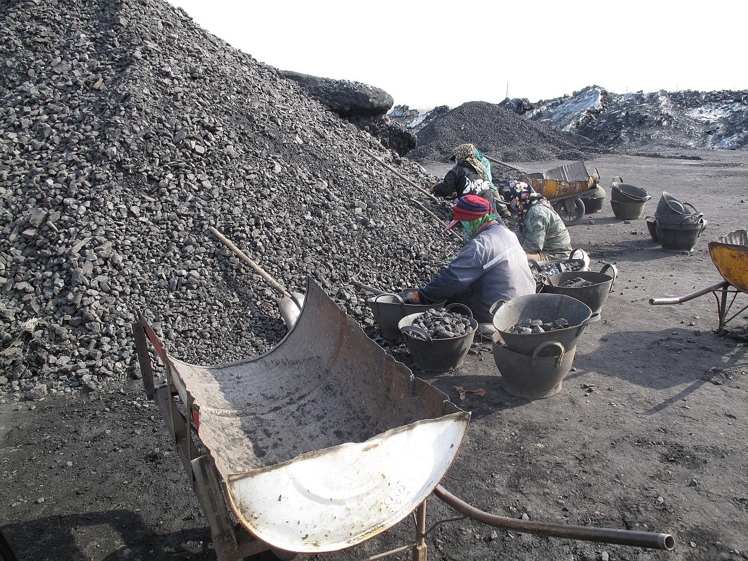Workers at a mine owned by Longmay Mining Group in Shuangyashan, Heilongjiang province. Thousands of Longmay miners who said they had not been paid took to the streets earlier this month after the Heilongjiang governor told reporters that no miner wo
