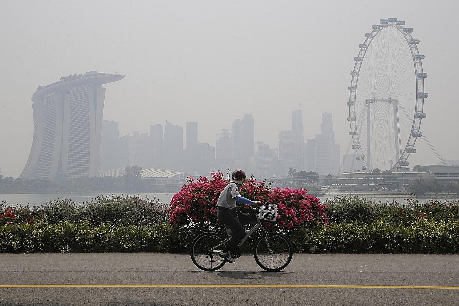 Haze shrouding the Marina Bay area last October. Singapore has been hit badly by haze over the years and recognises that it has a part to play in fighting the problem.