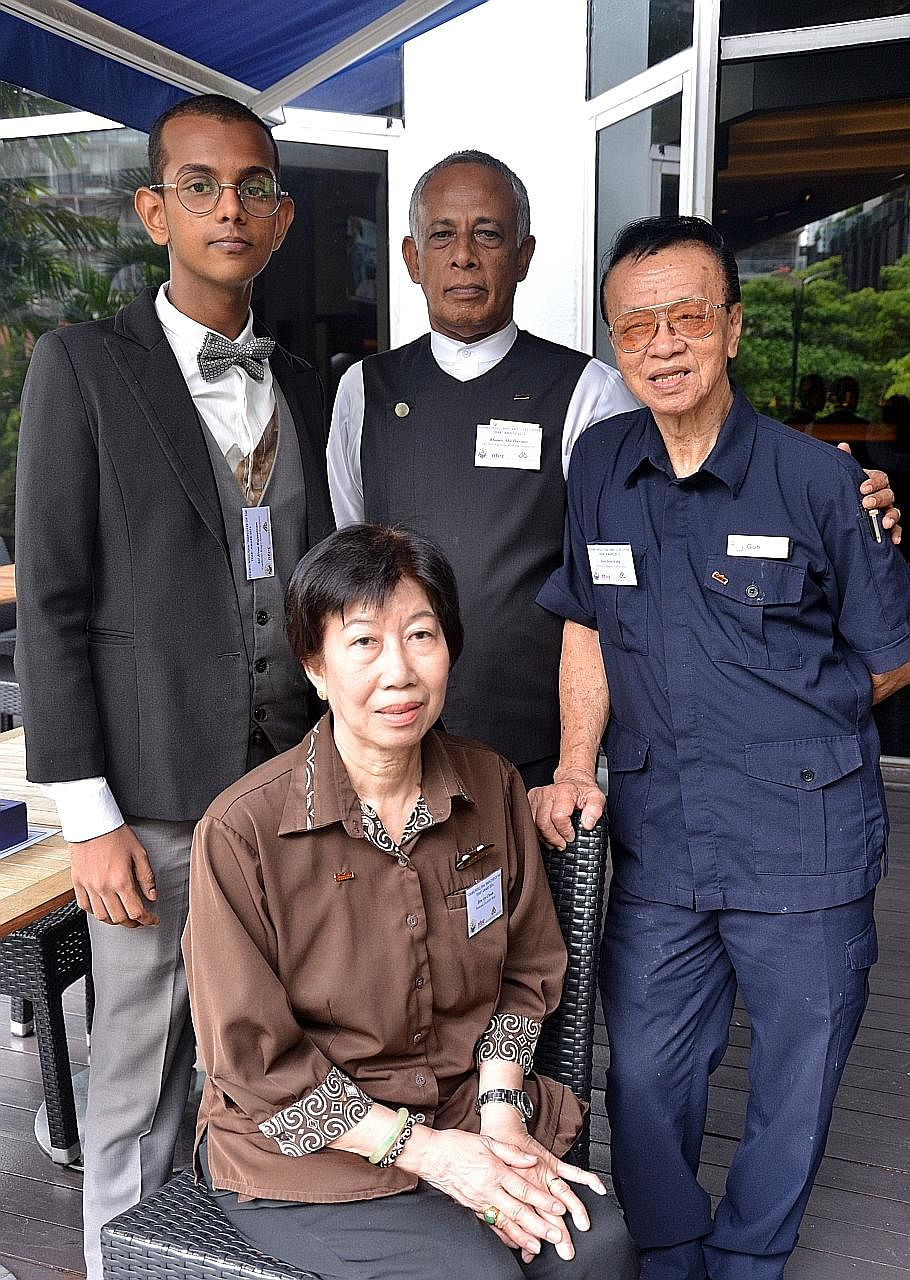 "(Clockwise from left) Mr Sri Jivan Rajaratnam, Mr Khamis Abu Hussain, Mr Goh Jeow Hong and Madam How Aye Choon were among the winners of the ""employee of the year"" awards."