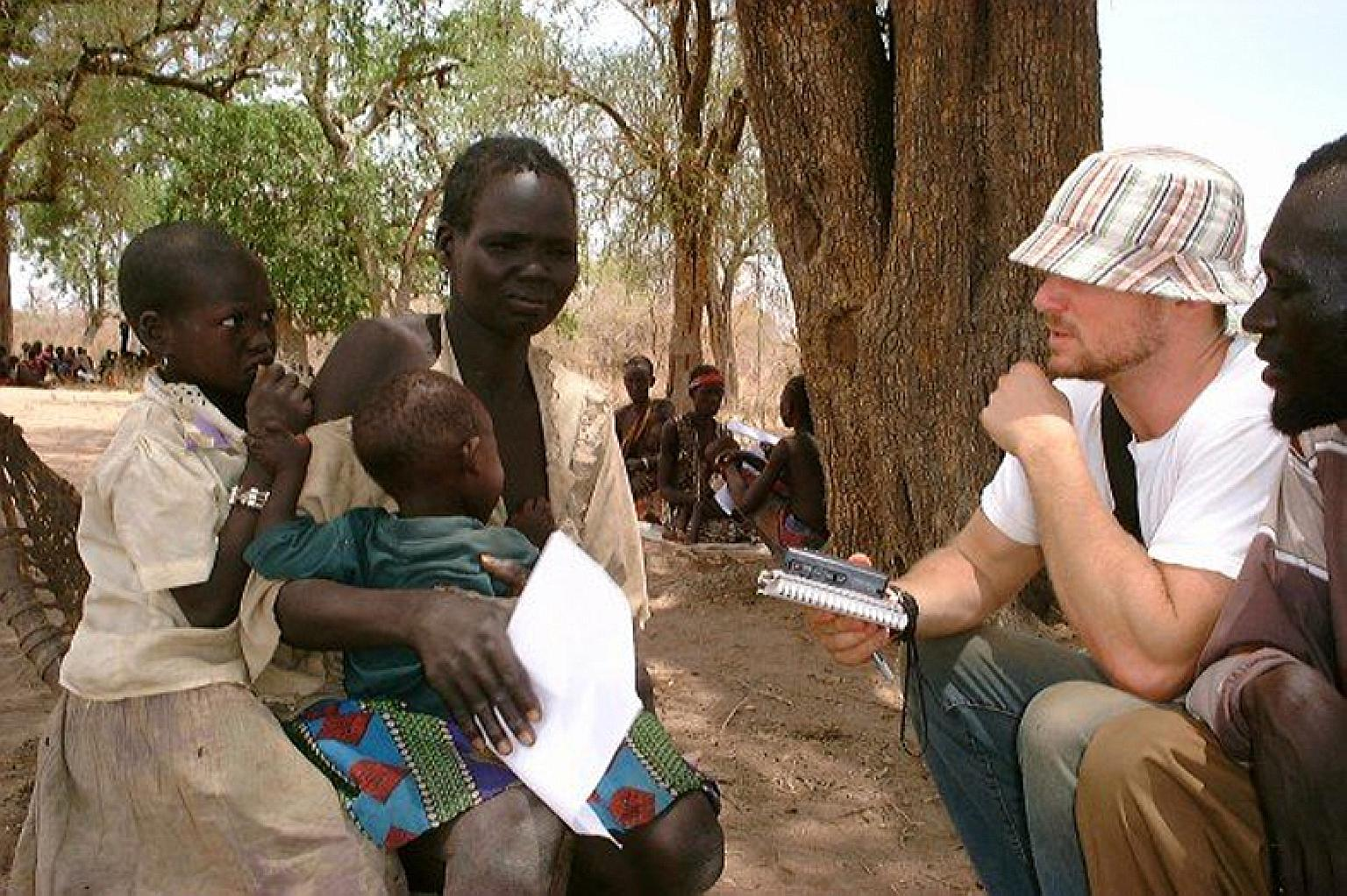 Mr Skinner on assignment in Sudan in 2003. He had persuaded Newsweek to let him fly to the front lines of the civil war there where slavery and human trafficking were booming. In Haiti, a man - just one of many traffickers who procure children from i