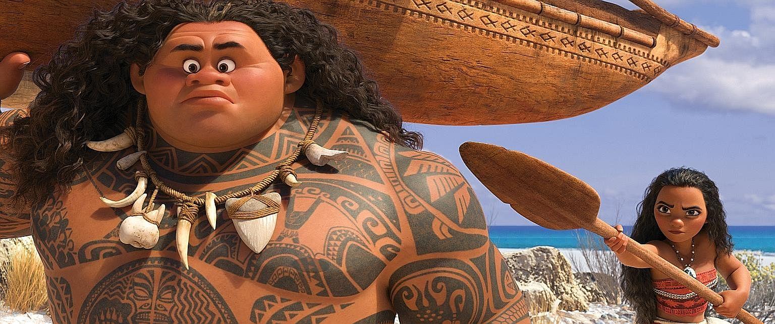 Demigod Maui (left, voiced by Dwayne Johnson) lends a hand to Moana's (Auli'i Cravalho) quest to look for a mythical island.