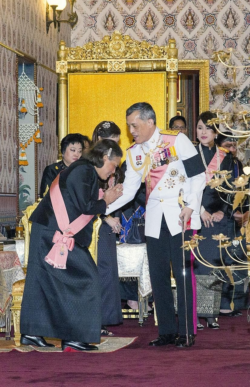 Then Crown Prince Maha Vajiralongkorn being greeted by his younger sister, Princess Maha Chakri Sirindhorn, at a royal funeral ceremony for the late Thai King Bhumibol at the Grand Palace in Bangkok on Thursday.