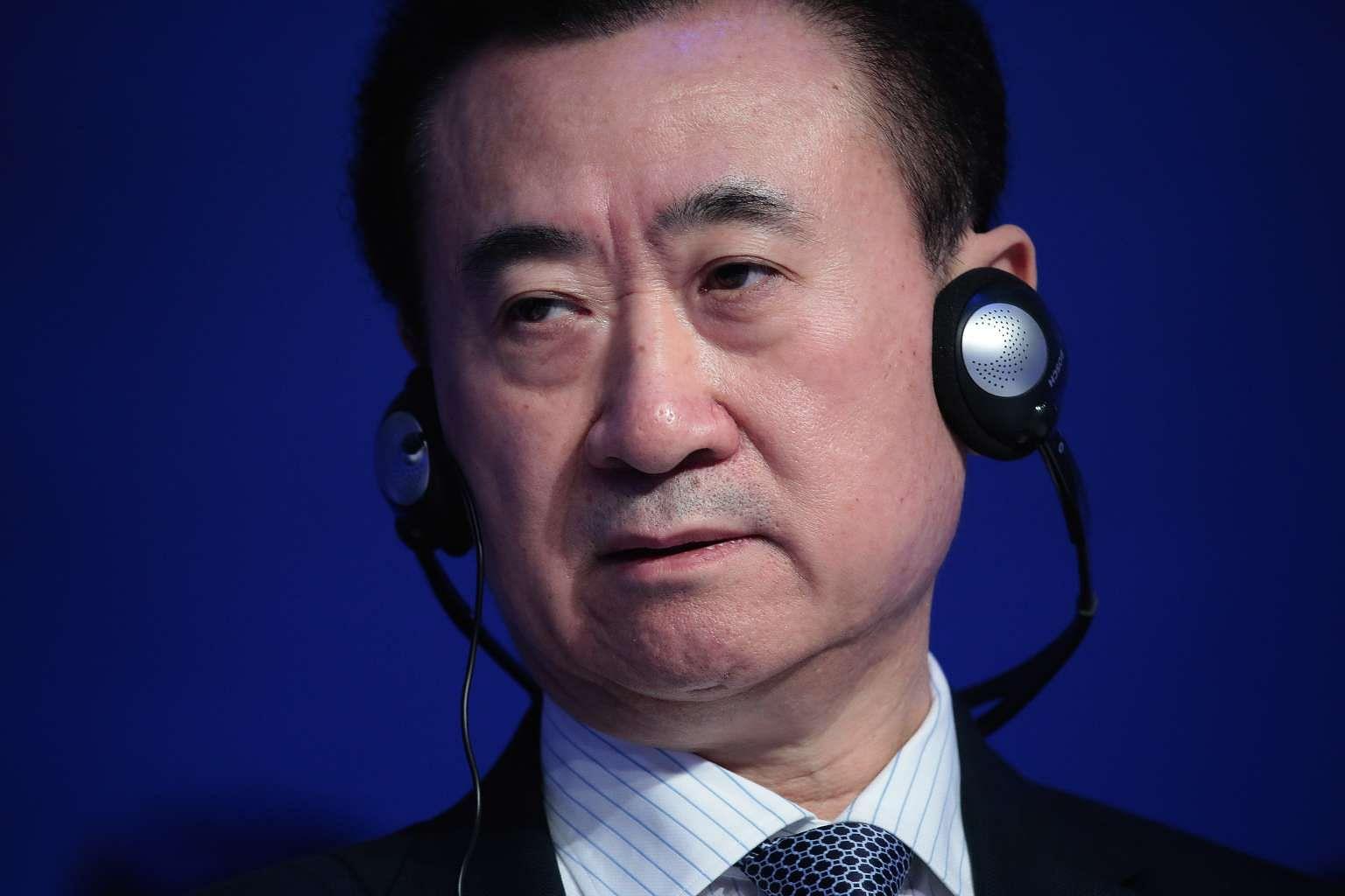 China's richest man Wang Jianlin warns Donald Trump against