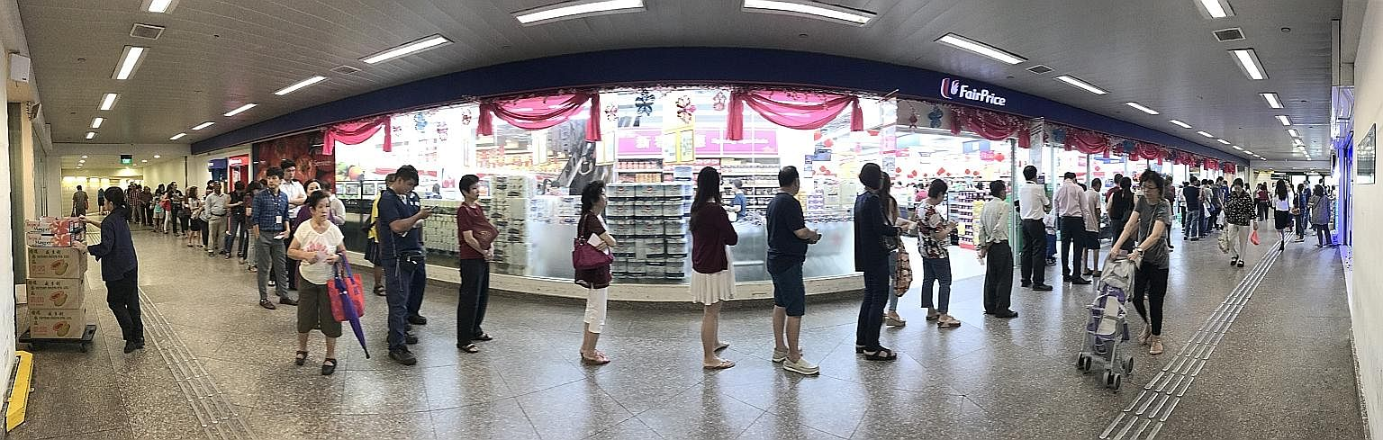 It is that time of the year again, when punters around the island try their luck at the annual Toto Hongbao Draw, worth $12 million this year. At the FairPrice outlet near Toa Payoh MRT station (above) at about 1pm yesterday, more than 80 people were