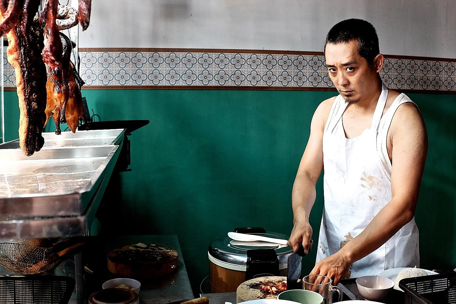 Roast pork seller Quan (Sunny Pang) grapples with an unhappy wife in Siew Lup.