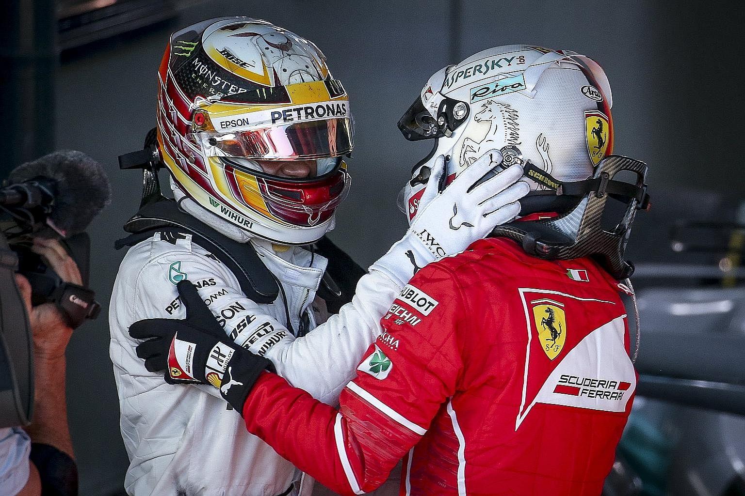 Mercedes' Lewis Hamilton (left) congratulating Sebastian Vettel after the Ferrari driver beat him by nearly 10 seconds.