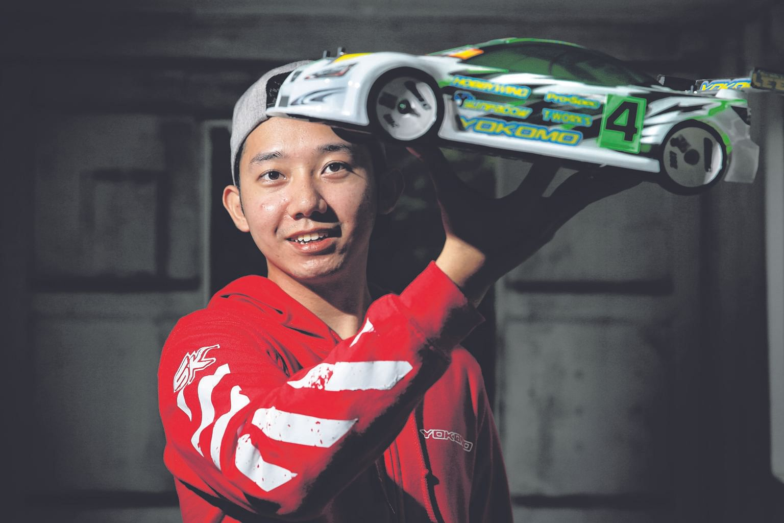 Mr Lee's accreditation and medal have pride of place on the 25-year-old's noticeboard above his work desk. He took ninth place in last year's Ifmar 1/10 Touring Car World Championships held in Beijing. Ifmar, or the International Federation of Model