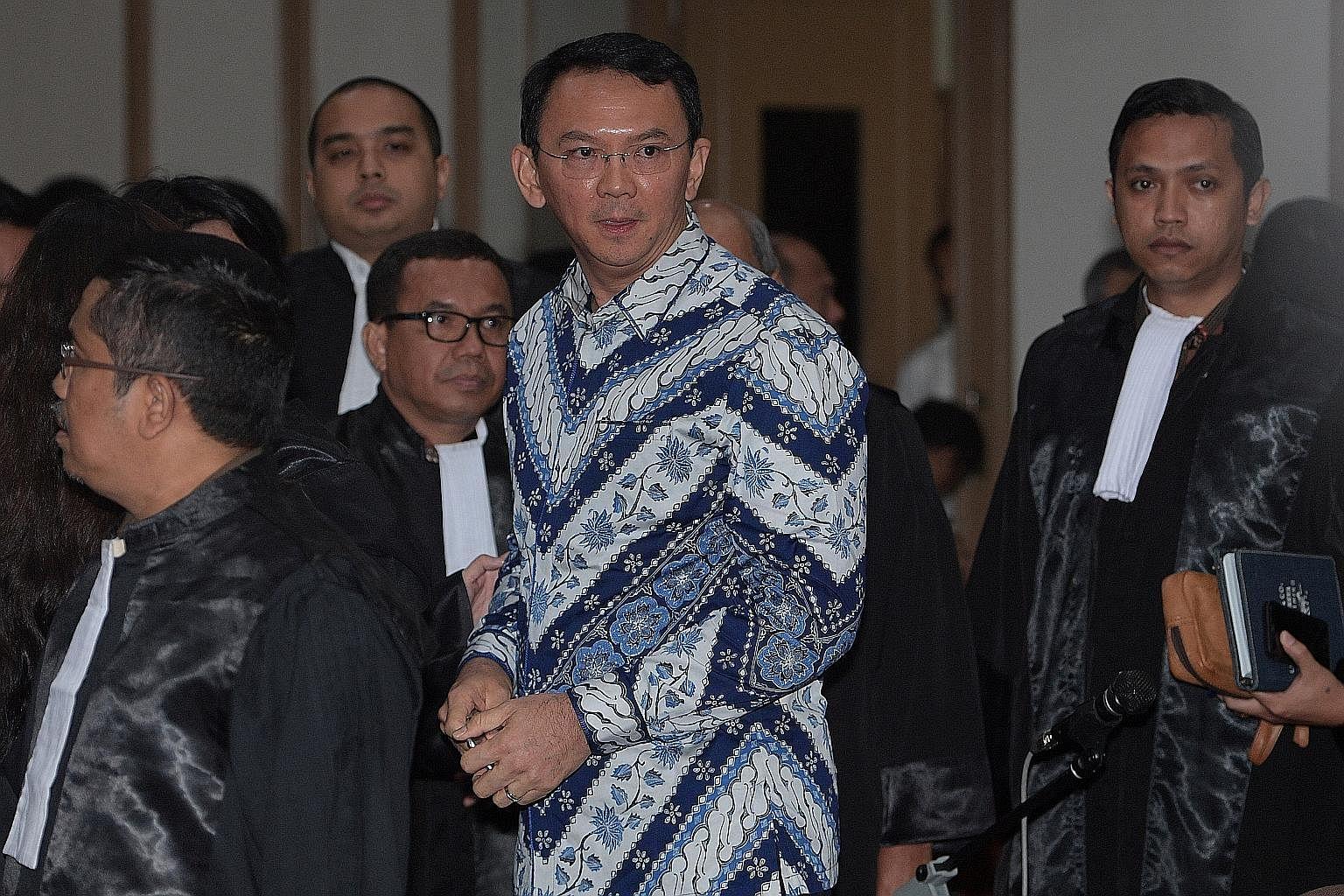 Hardline Muslims cheer jailing of Jakarta's Christian governor
