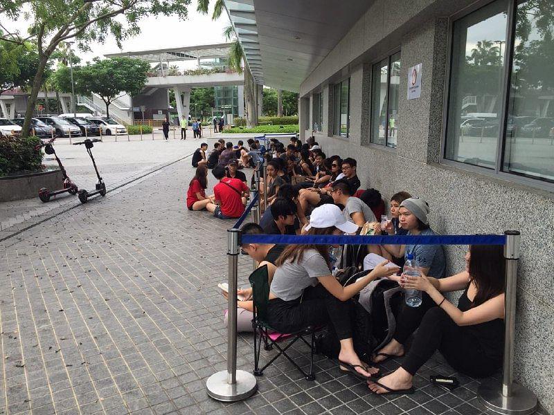 Fans of British singer Ed Sheeran queue overnight for
