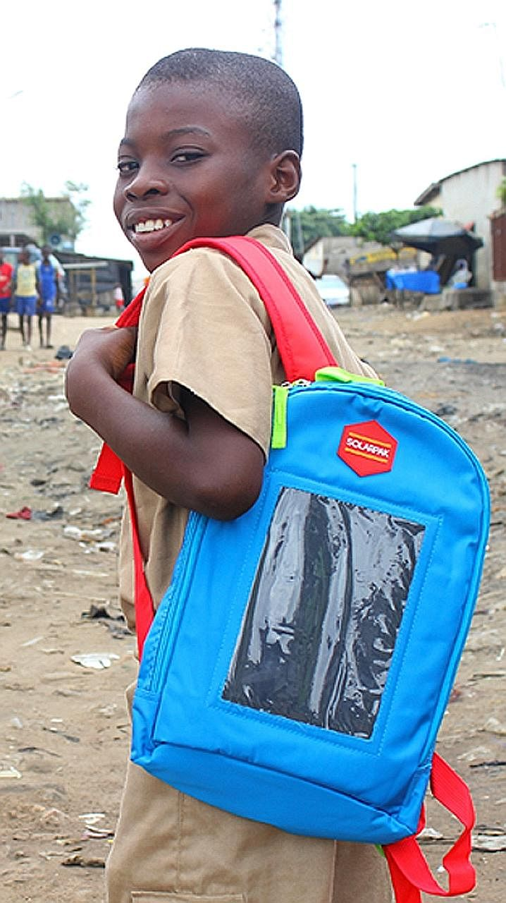 An Ivorian child carrying a Solarpak. Mr Evariste Akoumian hopes his project will provide easy access to electricity in Africa, where 700 million people live without power.