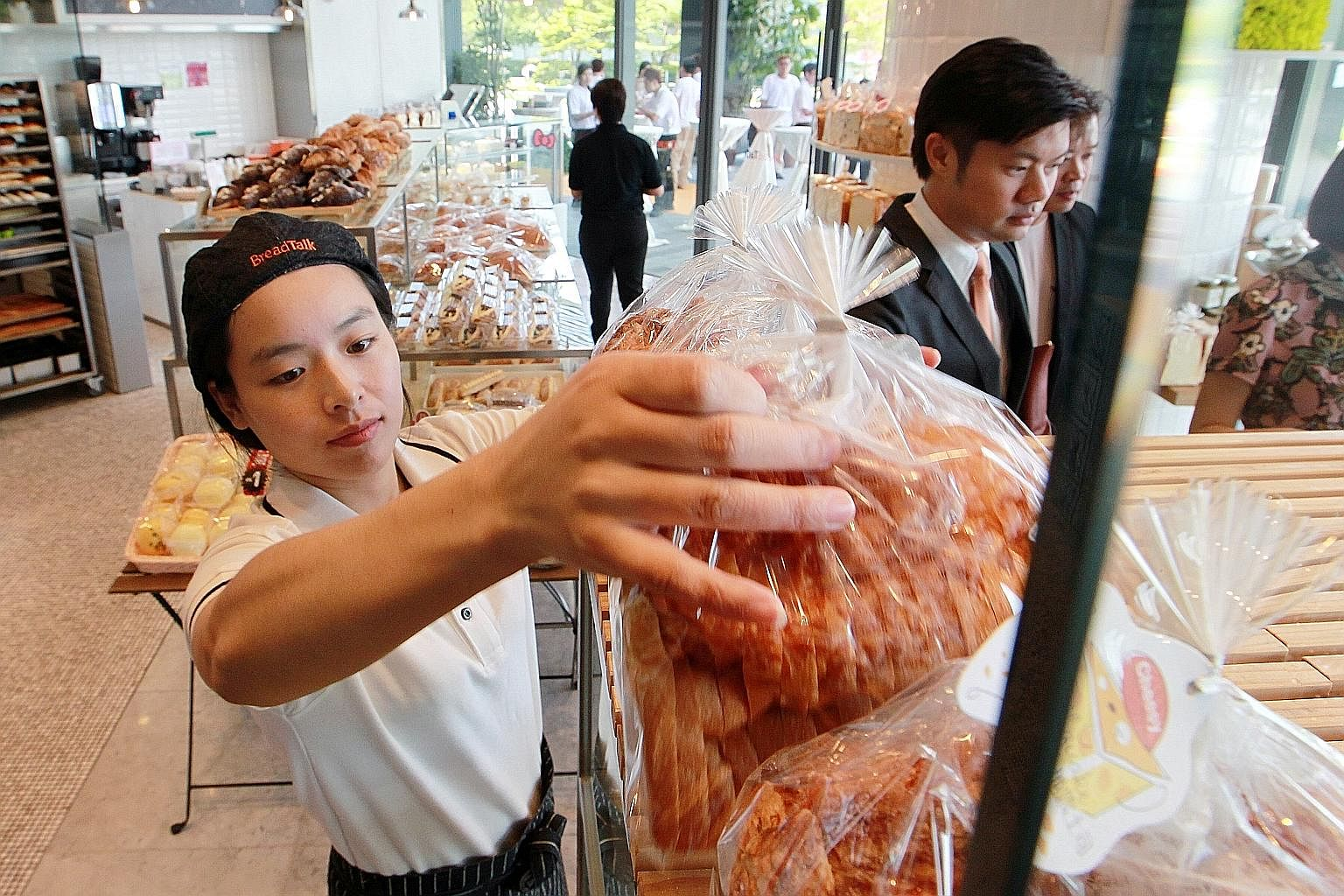 BreadTalk staff ensure confections are properly covered on shelves or kept in their packaging.