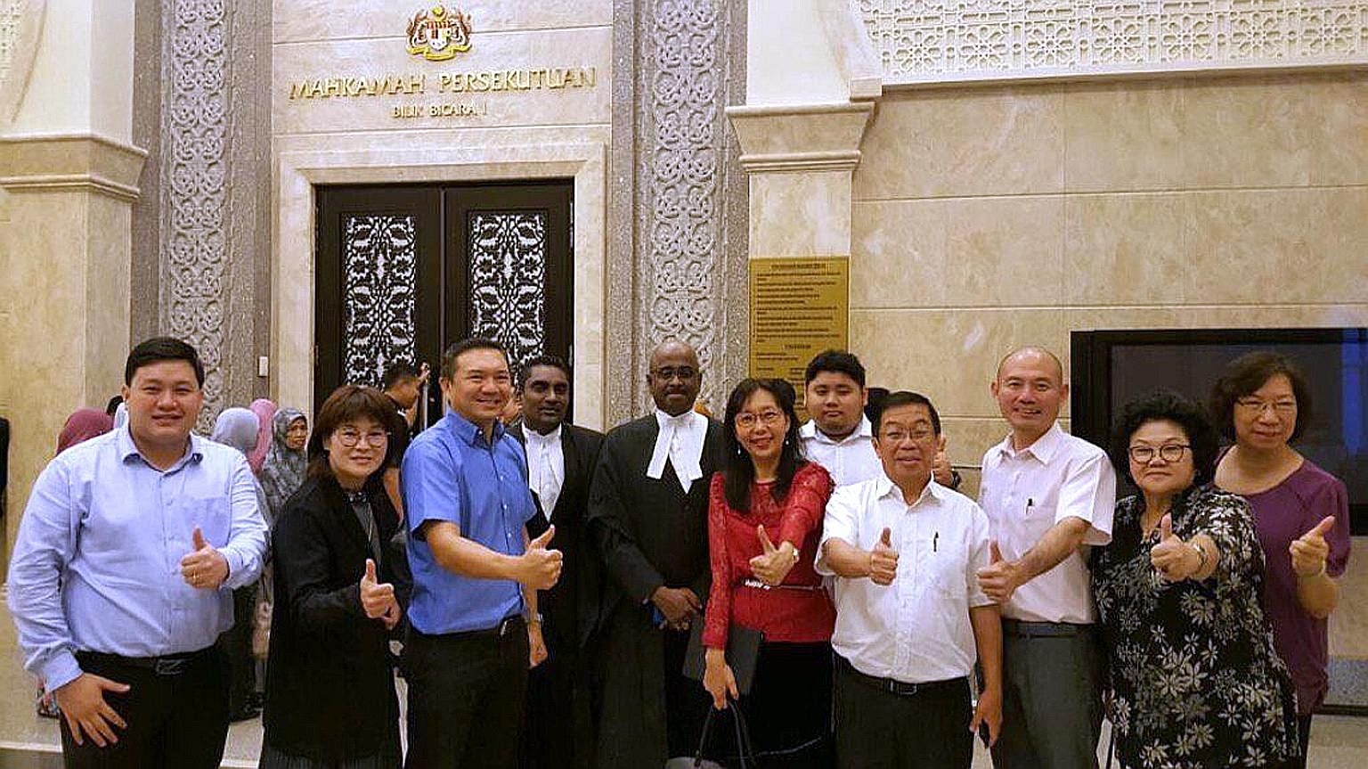 DAP MP Teresa Kok (in red) with her lawyers and supporters outside the Federal Court in Putrajaya yesterday. In 2008, she was held under the ISA for allegedly taking part in activities that could cause racial tension.