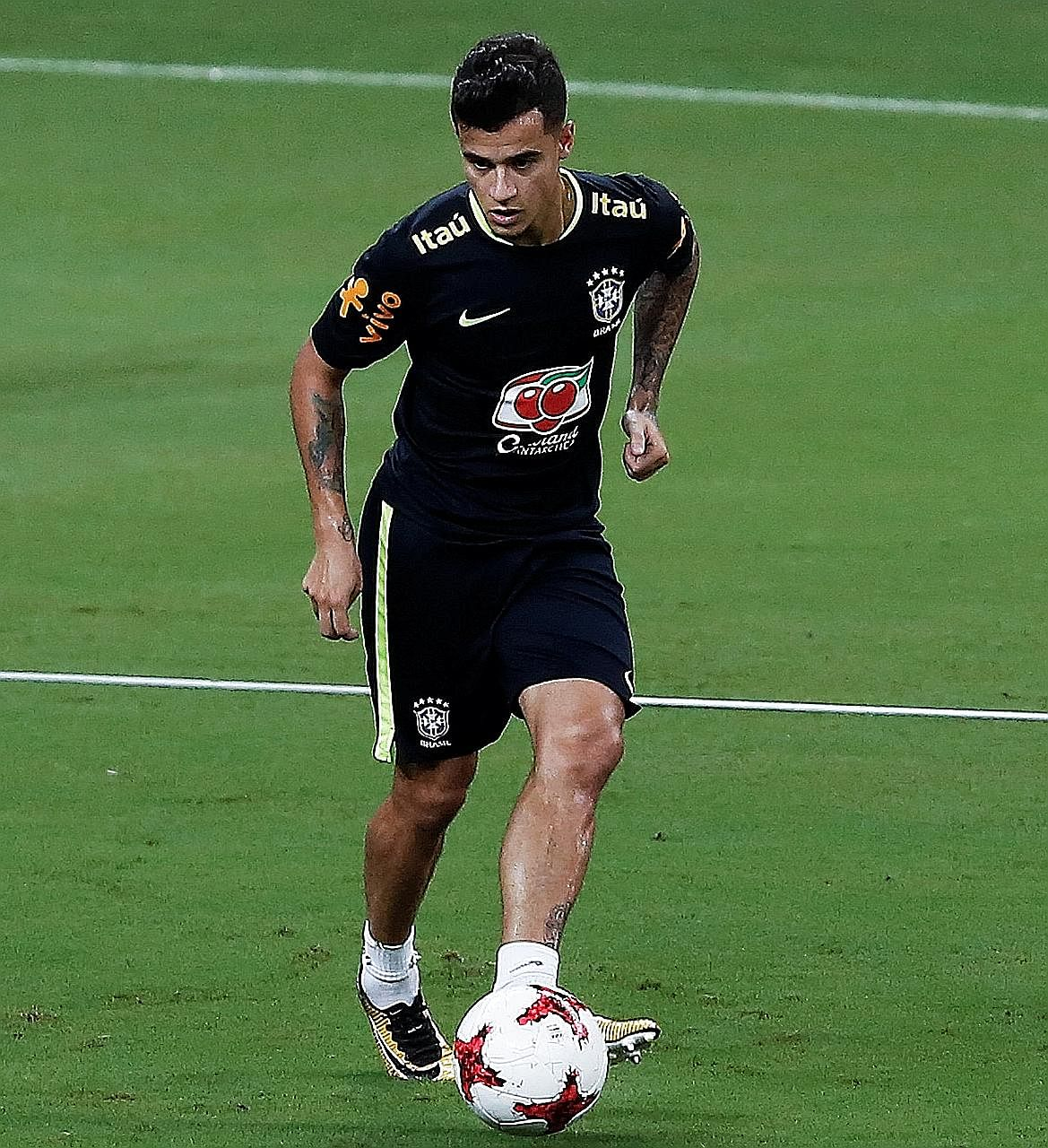 Philippe Coutinho training ahead of Brazil's World Cup qualifier against Colombia tomorrow. Having failed to obtain a move to Barcelona, he will need to work his way back into Liverpool's first team as they have impressed without him.