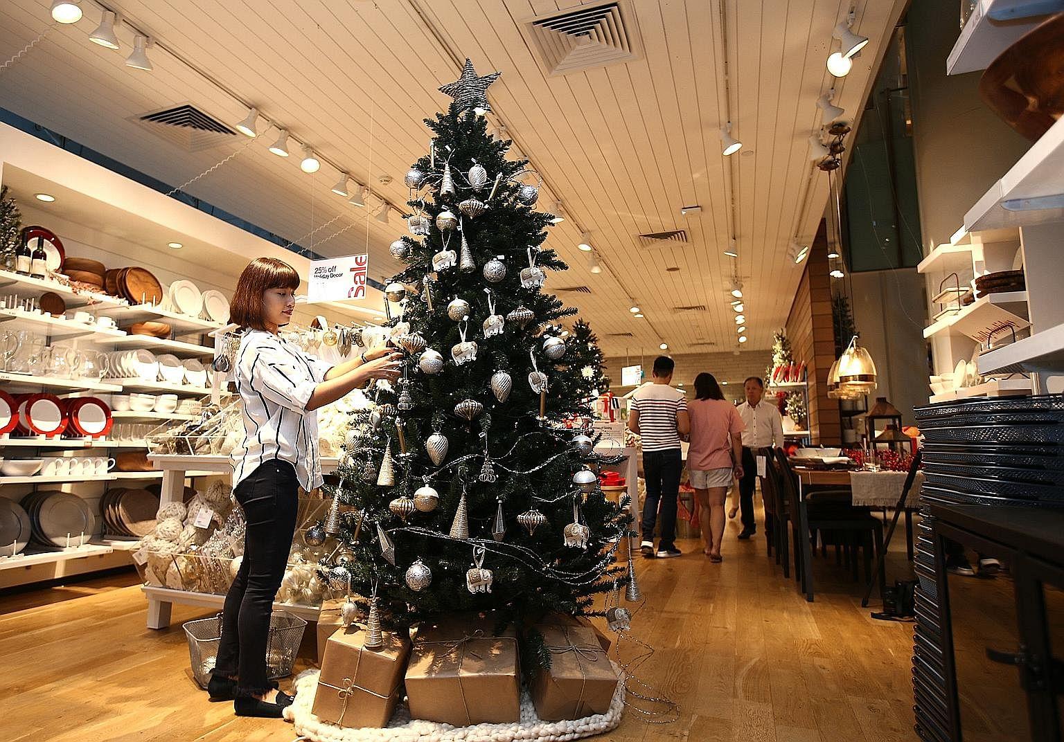 Using ornaments of various shapes makes the decorations on a tree look less boring, says Ms Jill Jeremiah Ng (top).