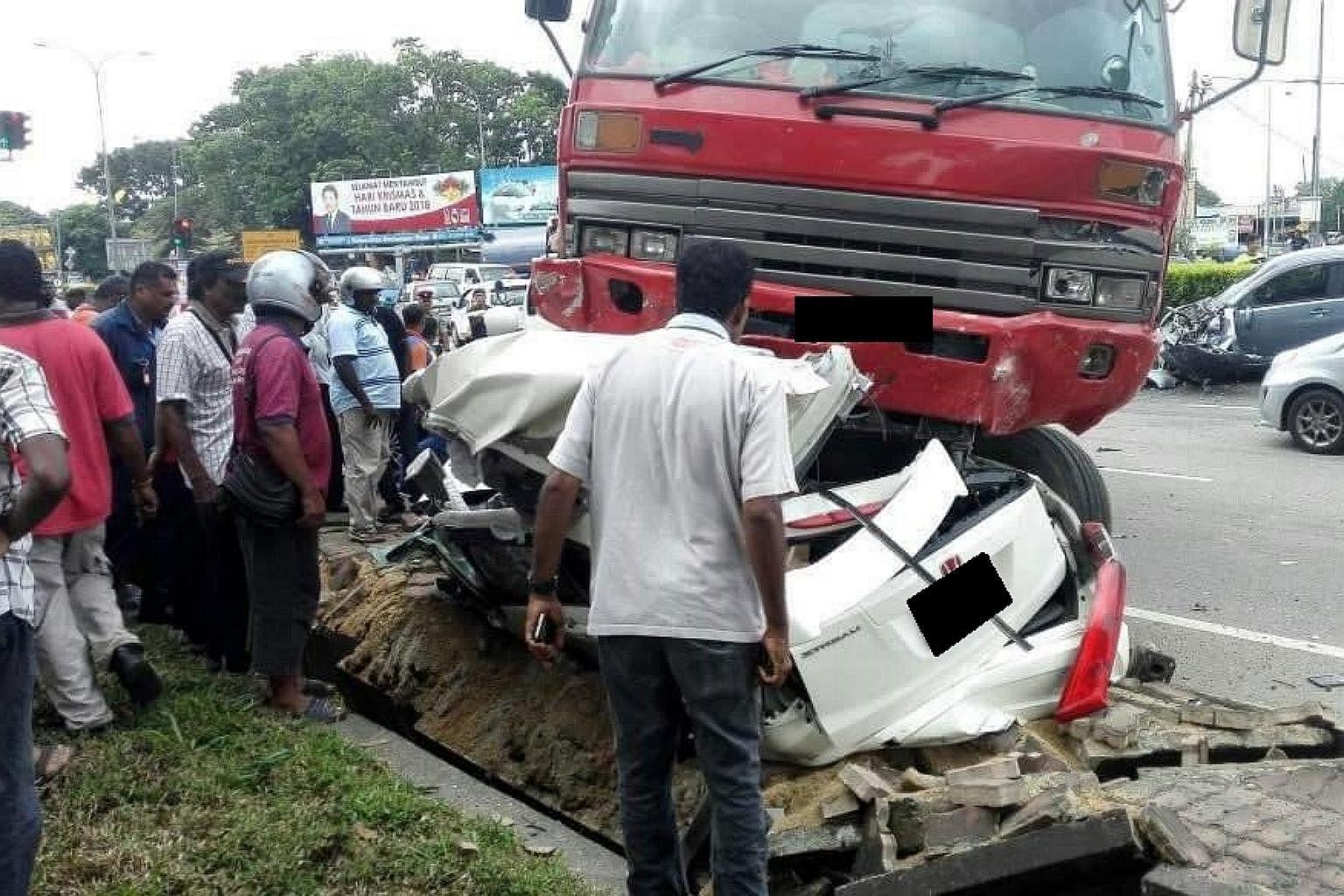 Port Dickson crash: 4 Singaporeans killed, truck driver arrested ...