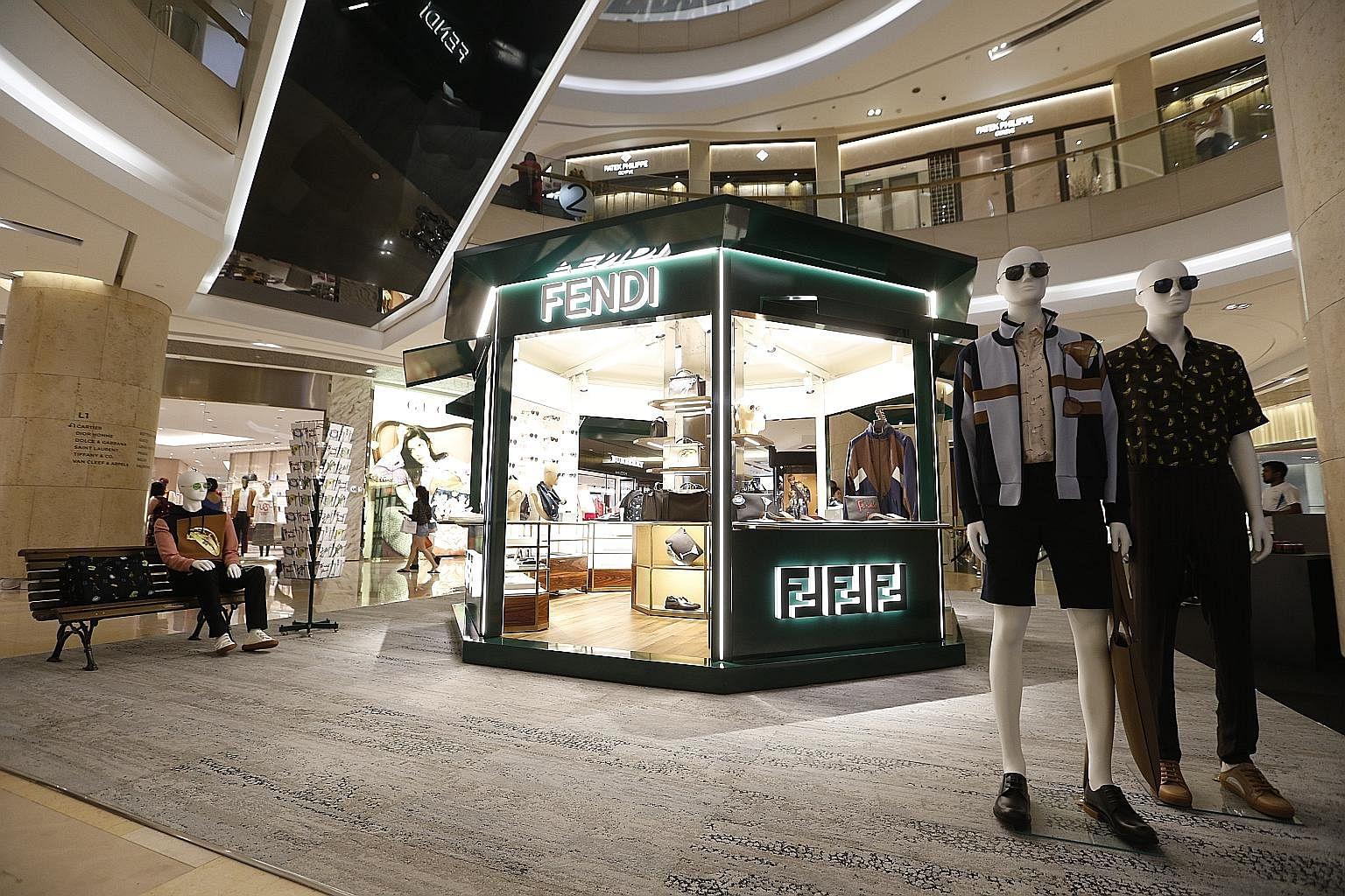 8934b29510 Pop-up kiosk celebrates opening of Fendi s fourth store here ...