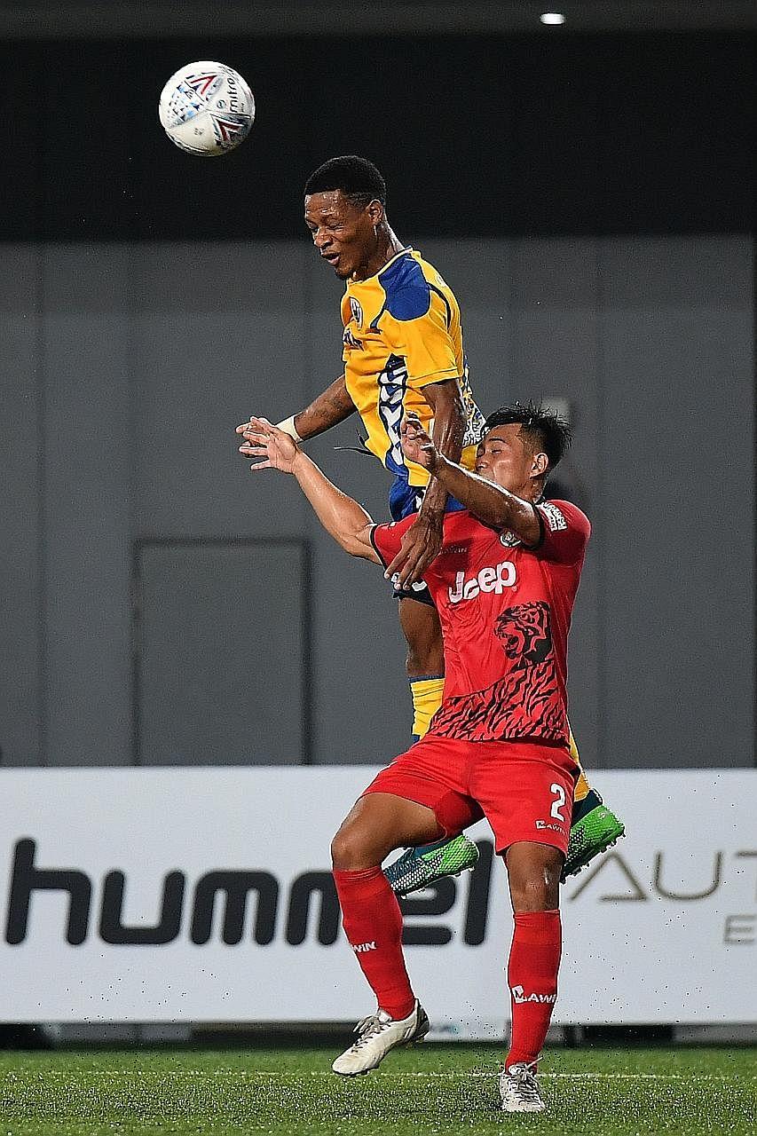 Tampines forward Jordan Webb rising above Balestier defender Muhammad Fadli Kamis at