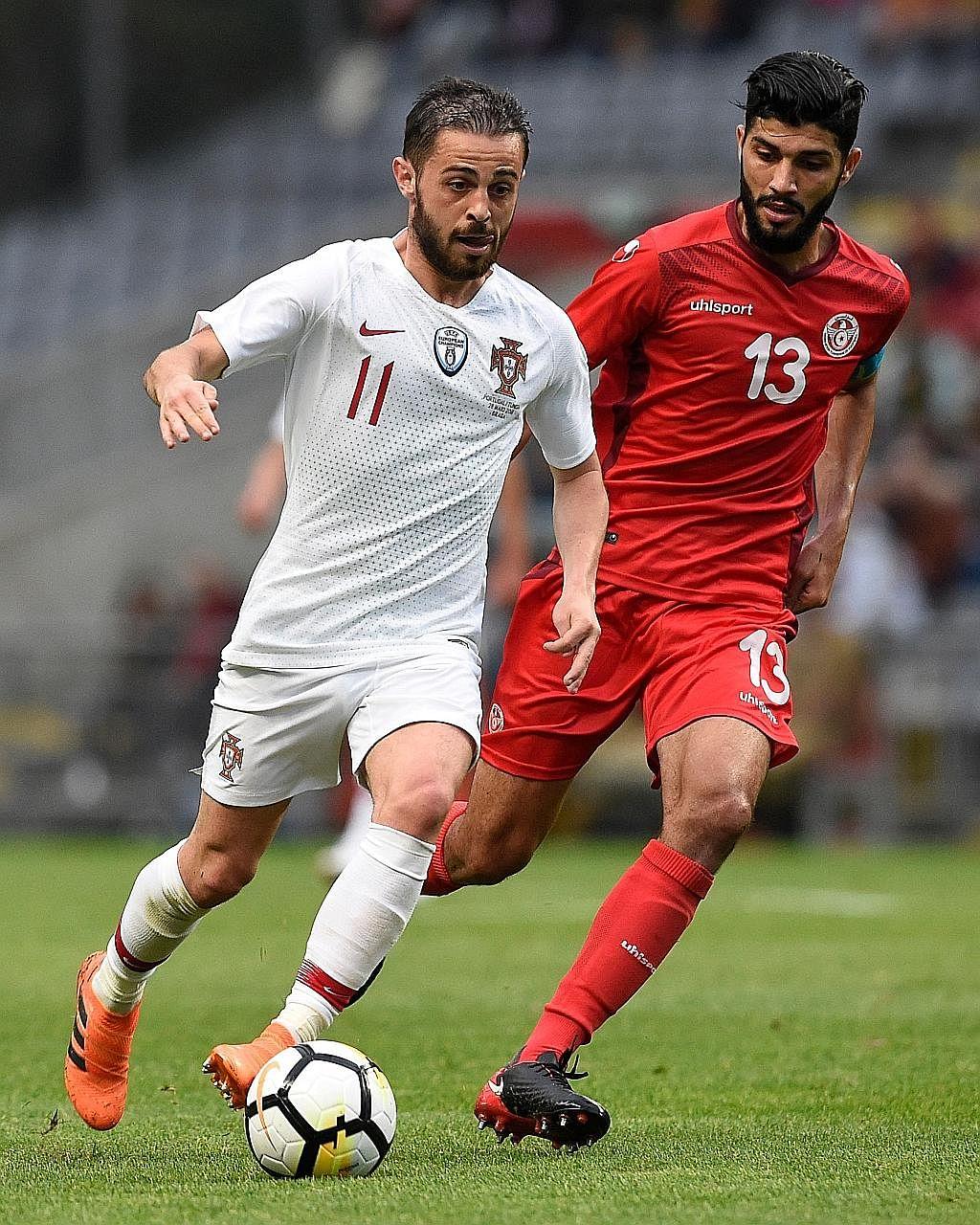 Portugal forward Bernardo Silva (left) being challenged by Tunisia midfielder Ferjani Sassi in their friendly match on Monday.