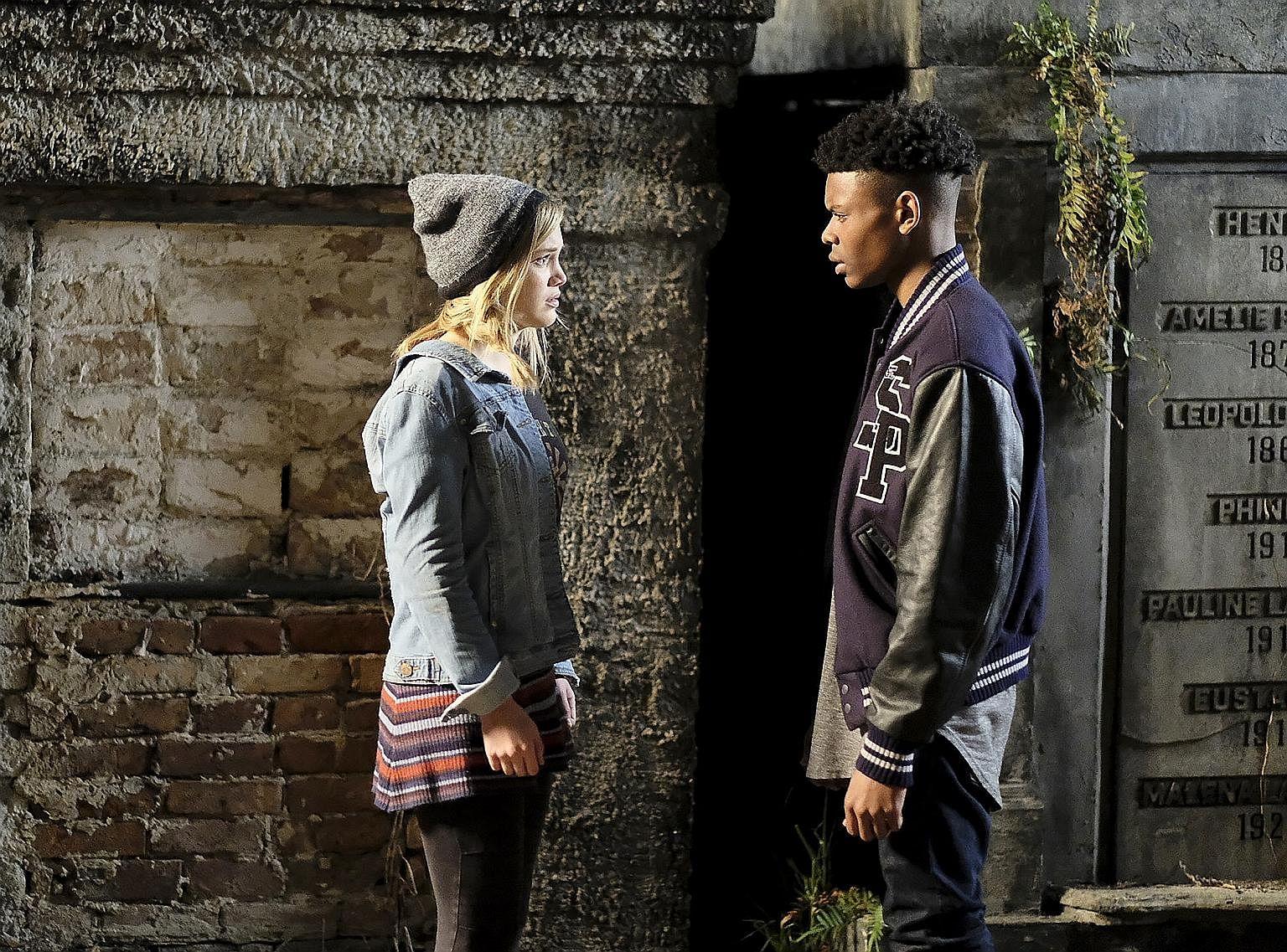 Olivia Holt and Aubrey Joseph in a scene from Cloak & Dagger.