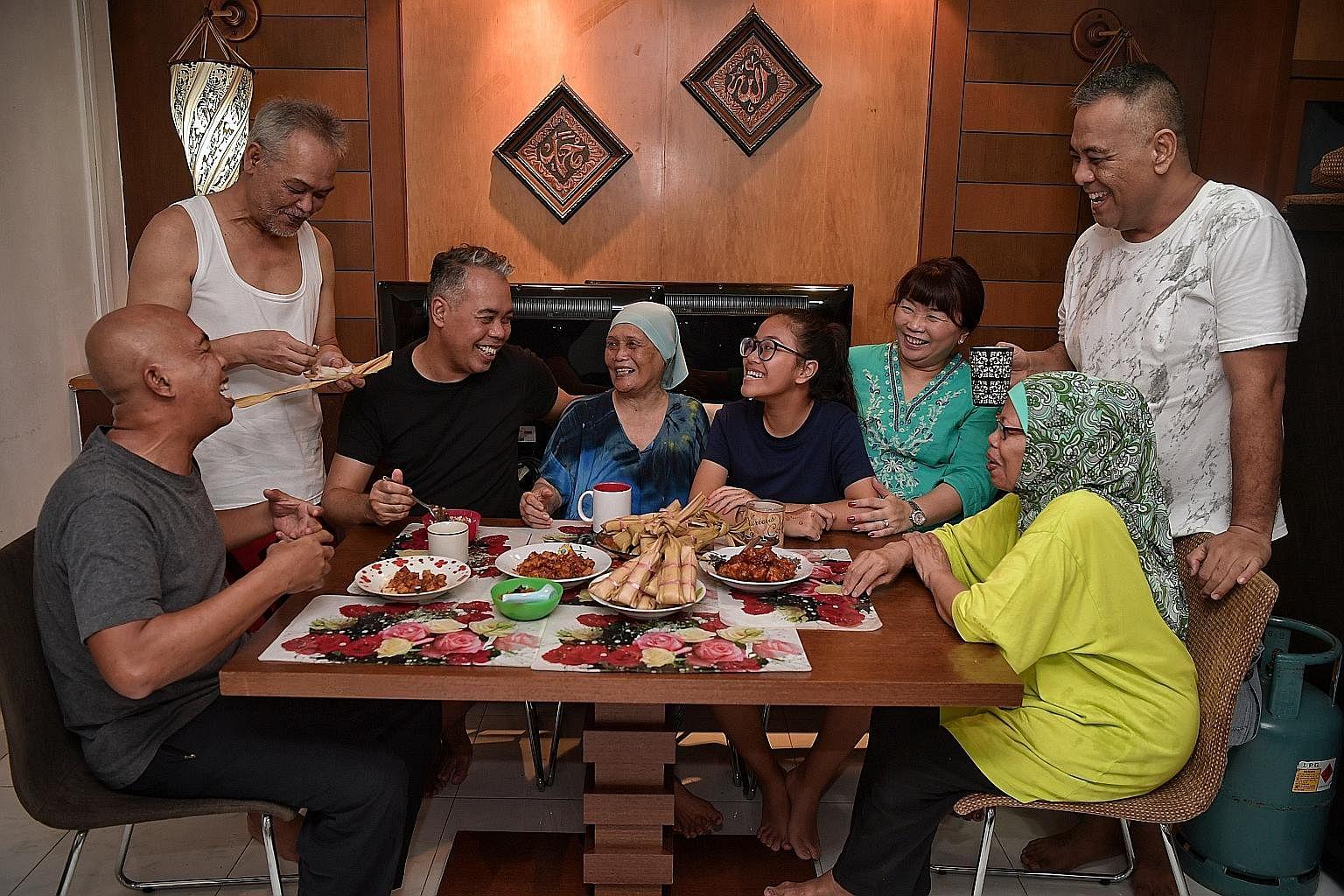 Family members Omar Hashid, 59; Mohd Noor Hashid, 61; Ismail Hashid, 53; Marseah Bonoh, 84; Qurratu'aini Choi Ismail, 14; Nur Qaisarah Alya Choi, 50; Marianah Hashid, 63; and Zulkefli Hashid, 46; taking a break from the cooking yesterday.