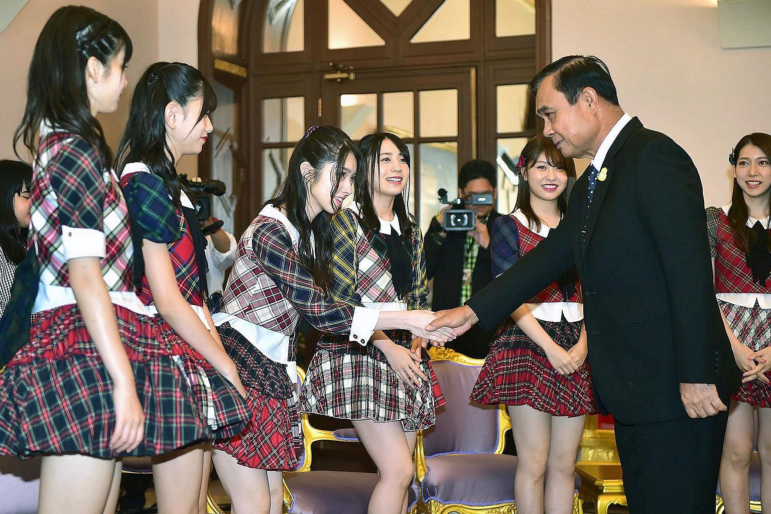Thai PM Prayut hosts J-pop girl group AKB48, in move seen as