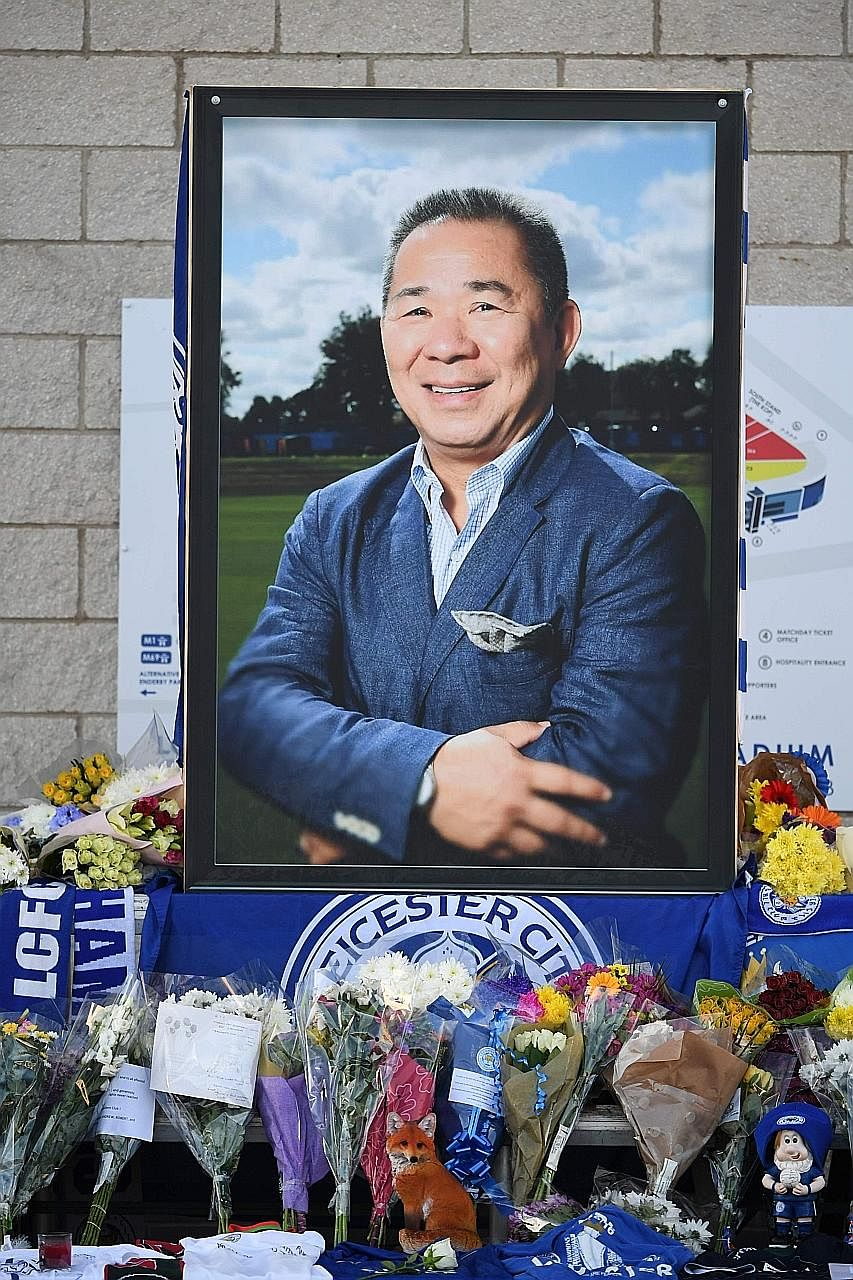 A portrait of Leicester City's chairman Vichai Srivaddhanaprabha at the King Power Stadium in the English city yesterday, surrounded by floral t