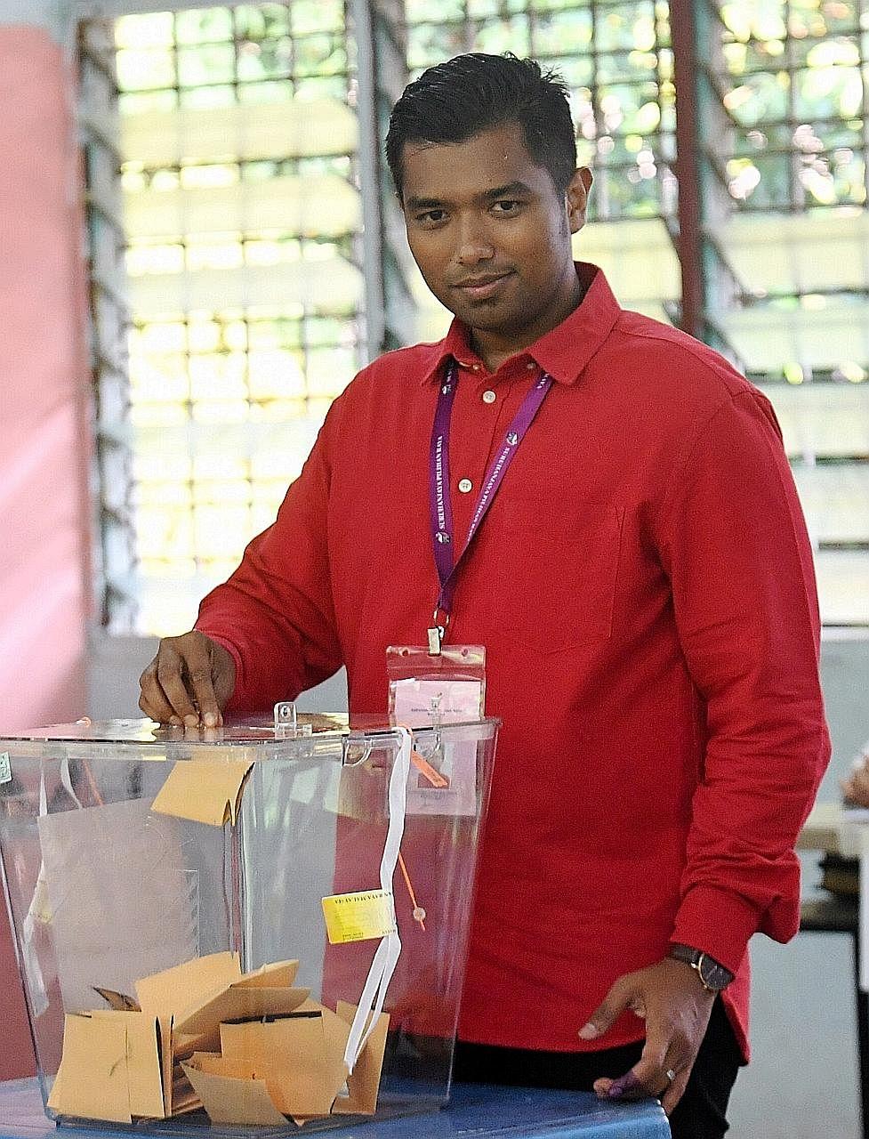 PH's Mr Muhammad Aiman Zainali, who lost, casting his vote yeste