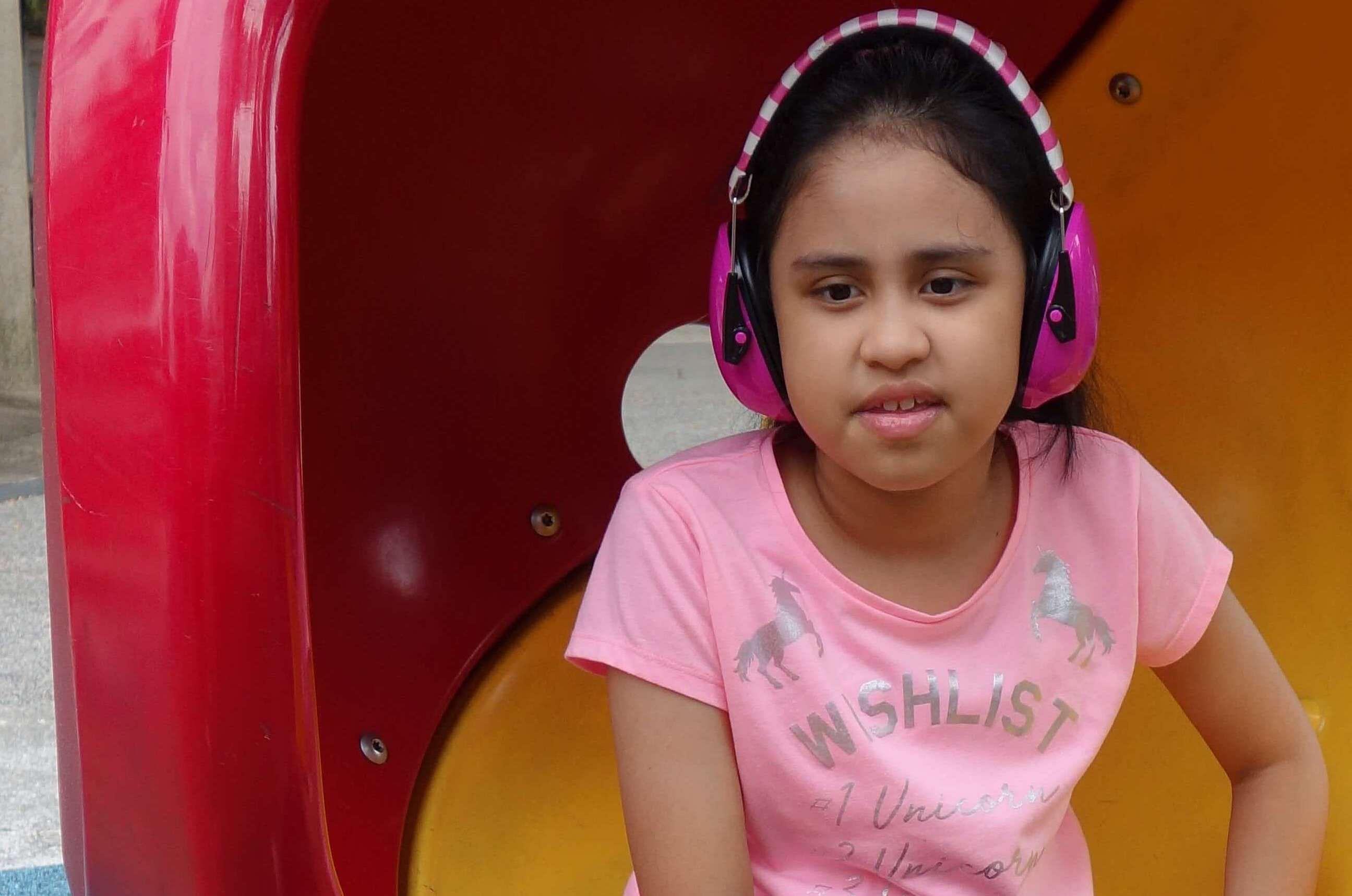 Natasha wearing headphones