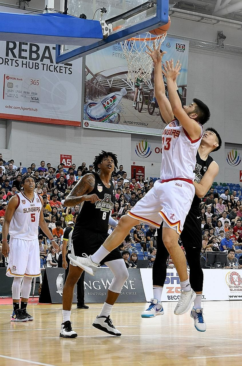 Delvin Goh outjumping two Macau Black Bears players at the OCBC Arena yesterday. He played a key role for the Singapore Slingers at both ends of the court, scoring on nine of his 10 field-goal attempts and grabbing eight rebounds in the 102-91 victor