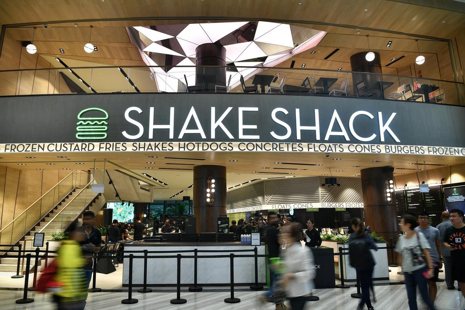 Snaking queue forms outside NY burger chain Shake Shack at