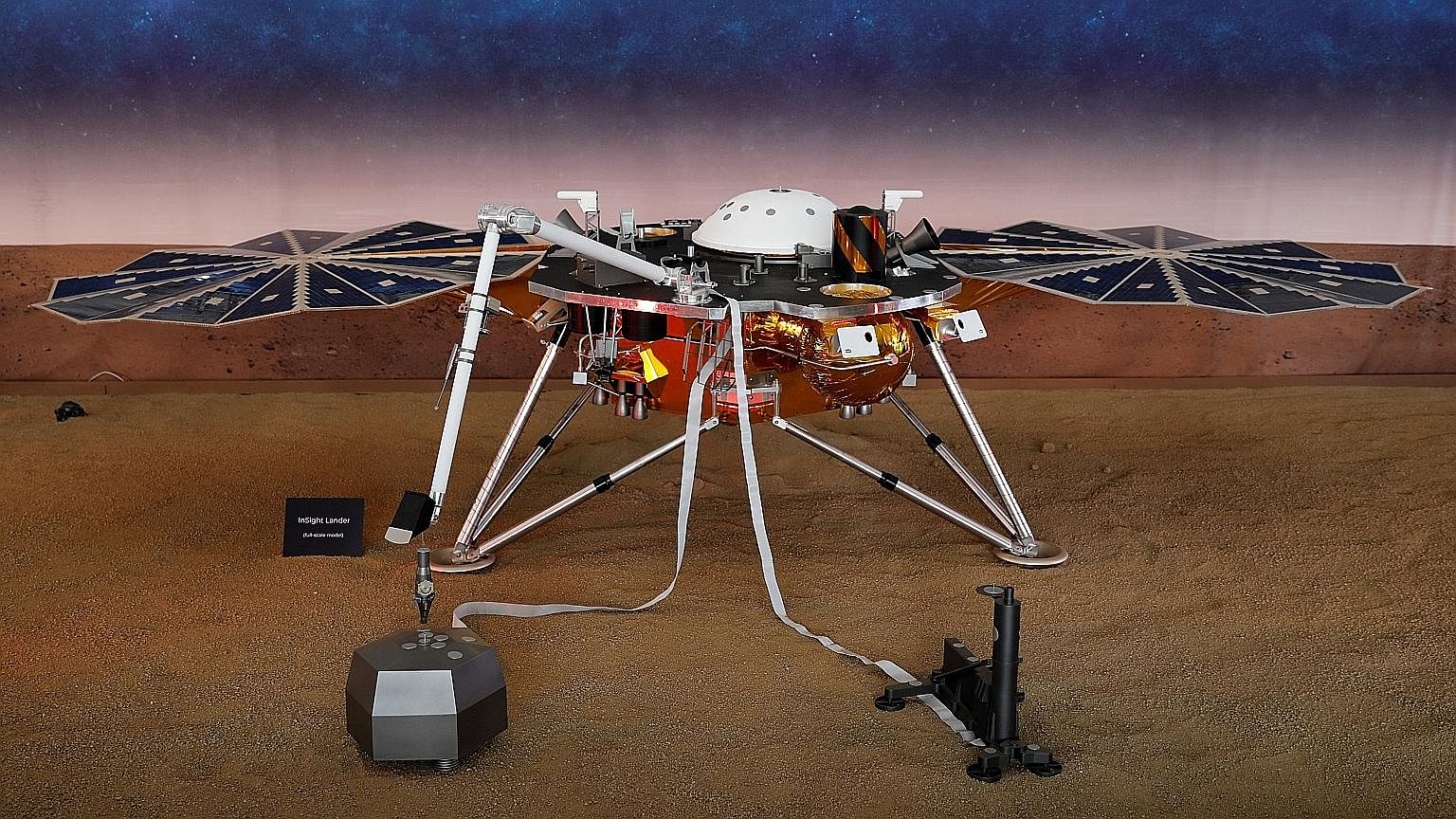 A life-size model of InSight, a robotic probe dedicated to studying Mars' deep interior, at the Jet Propulsion Laboratory.