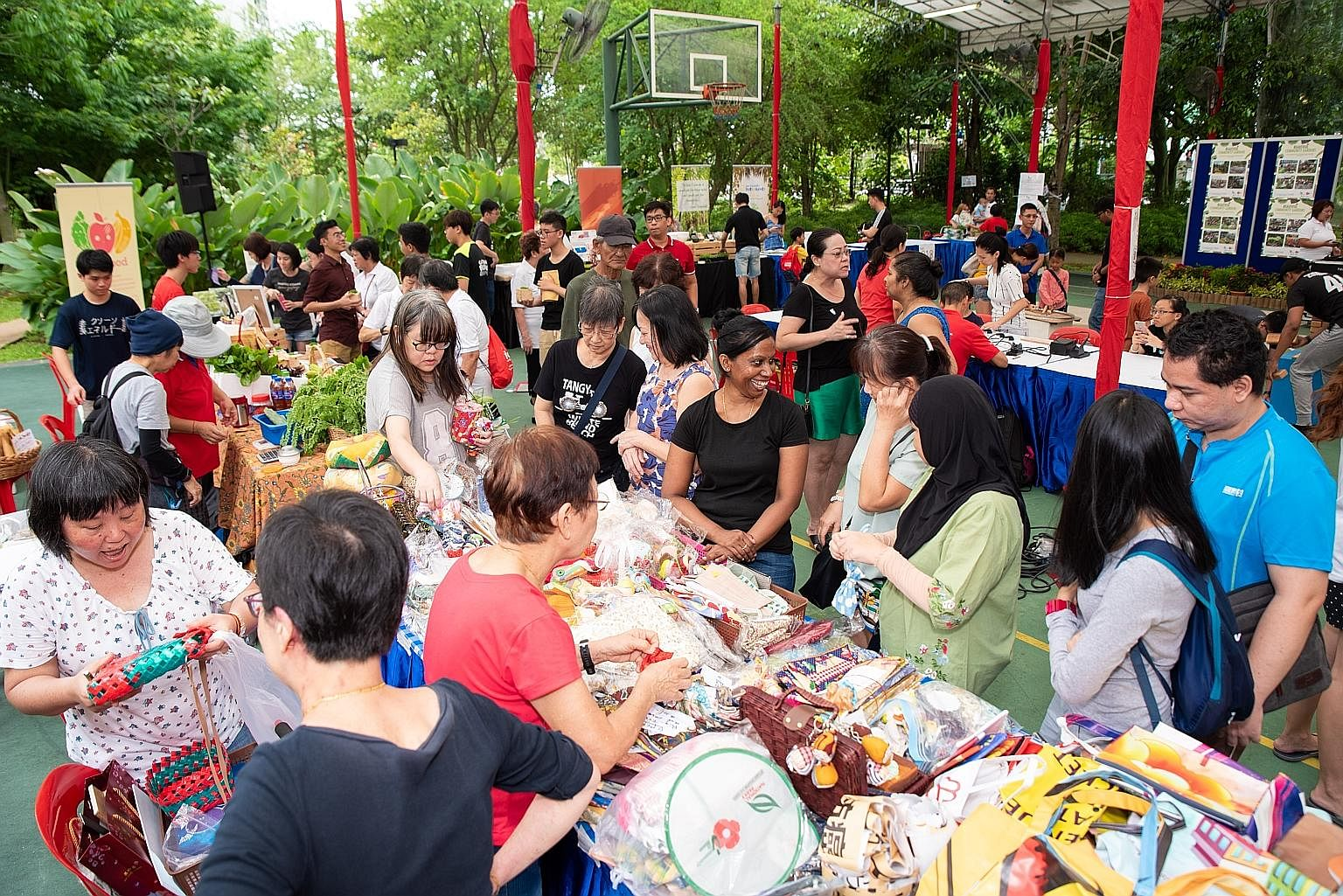 Residents taking part in an Earth Day fair at Nee Soon East on Saturday. Measures in the masterplan include setting up a chat group for residents to work together to share leftover food. By the year end, all leftover food at Nee Soon East events will