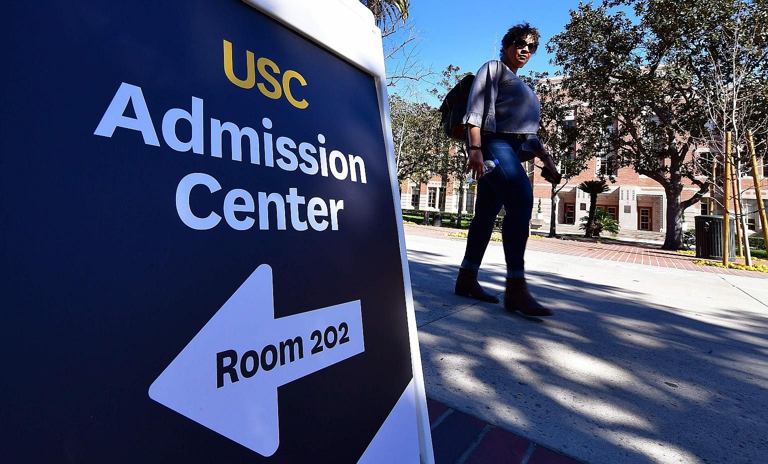 """College admissions consultant William """"Rick"""" Singer has pleaded guilty to charges related to the scandal, while actress Felicity Huffman (centre) and actress Lori Loughlin are allegedly involved. The University of Southern California (USC) in Los Ang"""
