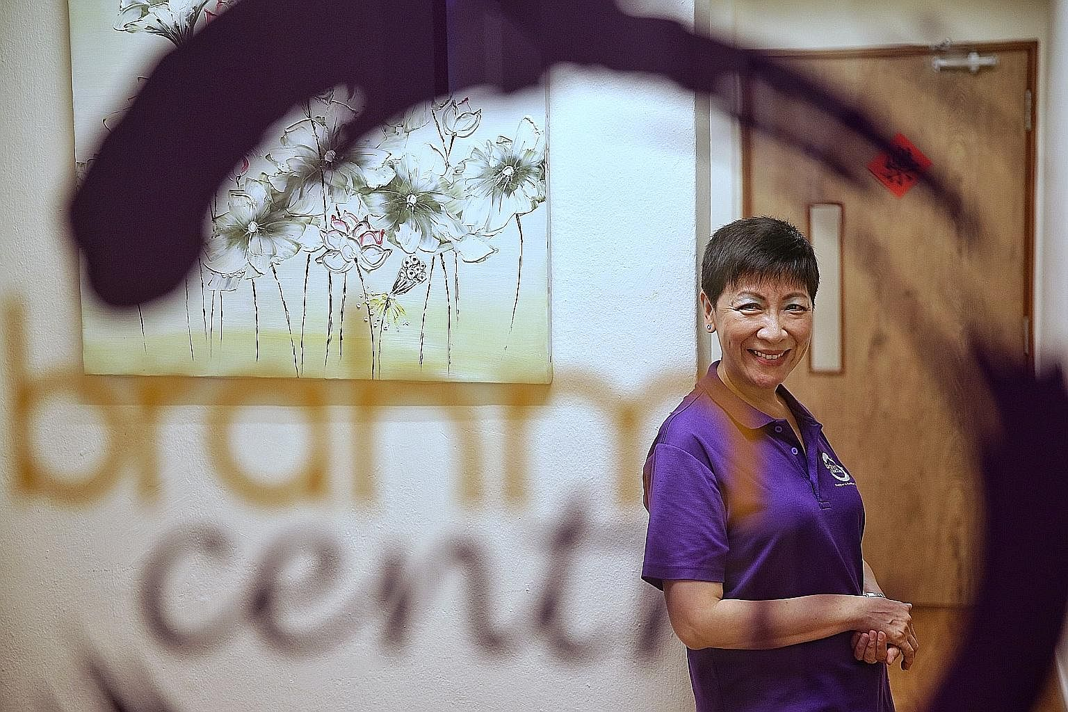 Ms Chew performing karate moves as a child, under the watchful eyes of her late father Chew Choo Soot, a karate grand master. After recovering from depression brought on by work stress and family issues, Ms Angie Chew, in 2012, set up Brahm Centre, a
