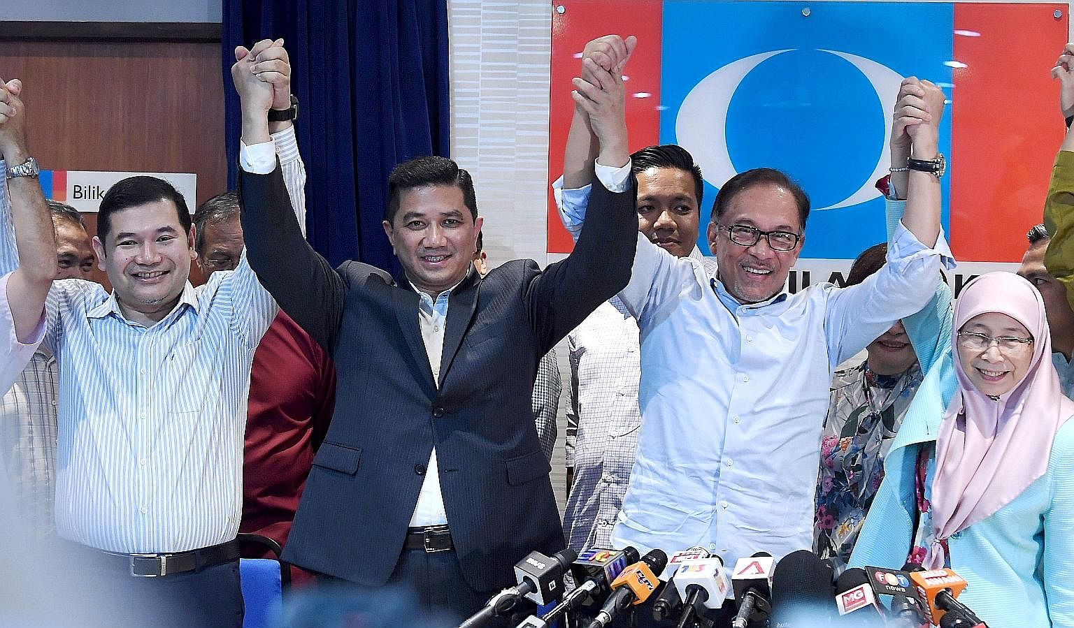 PKR president Anwar Ibrahim and PKR deputy president Azmin Ali, with PKR vice-president Rafizi Ramli (far left) and Mr Anwar's wife, Deputy Prime Minister Wan Azizah Wan Ismail, at a press conference on the Port Dickson by-election at the party's hea