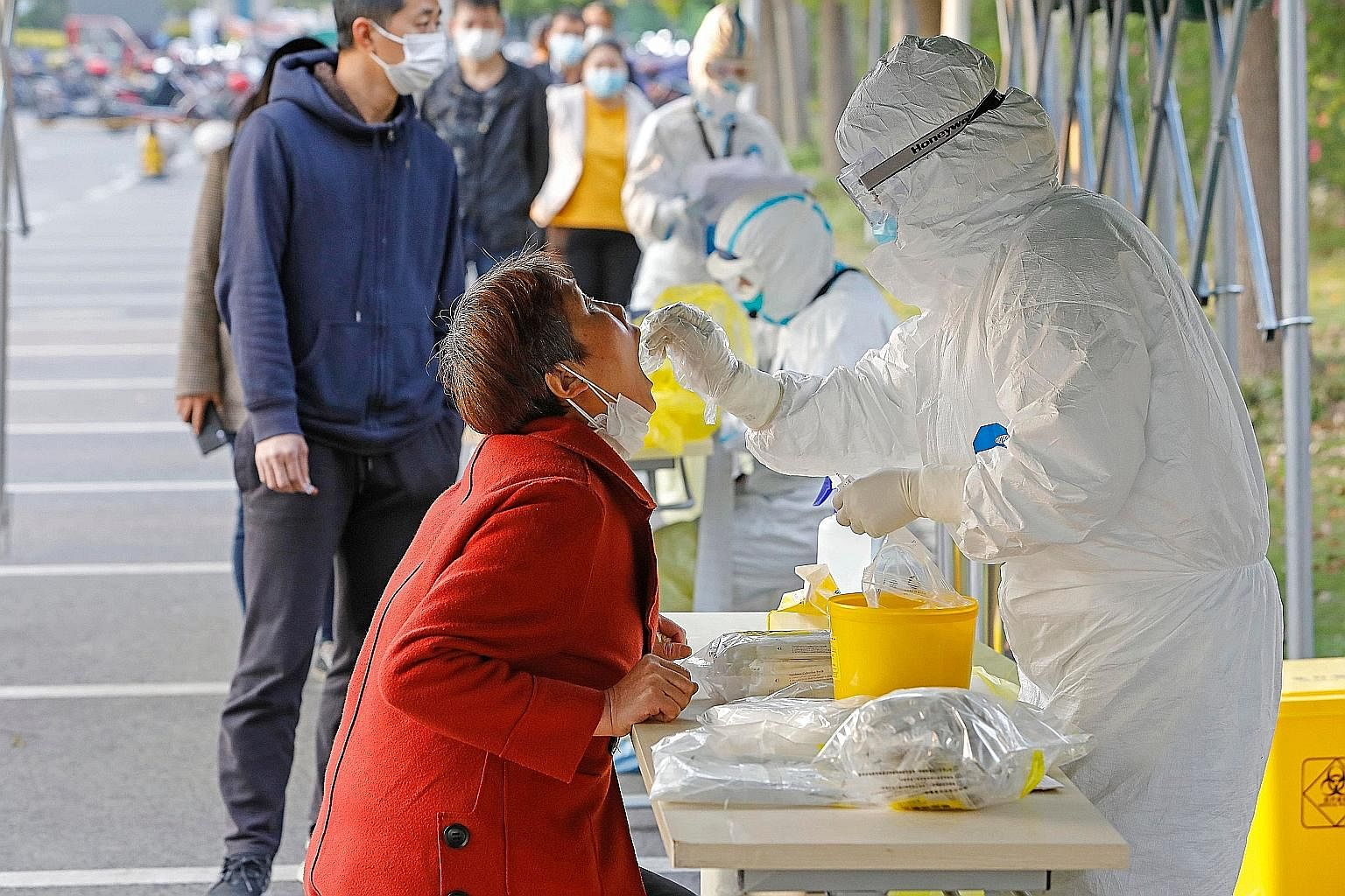 A woman getting tested for the coronavirus in Shanghai last month. Much of how EU-China relations will evolve will depend on whether the EU comes out of the Covid-19 crisis stronger or weaker, and whether US President Donald Trump will be re-elected,