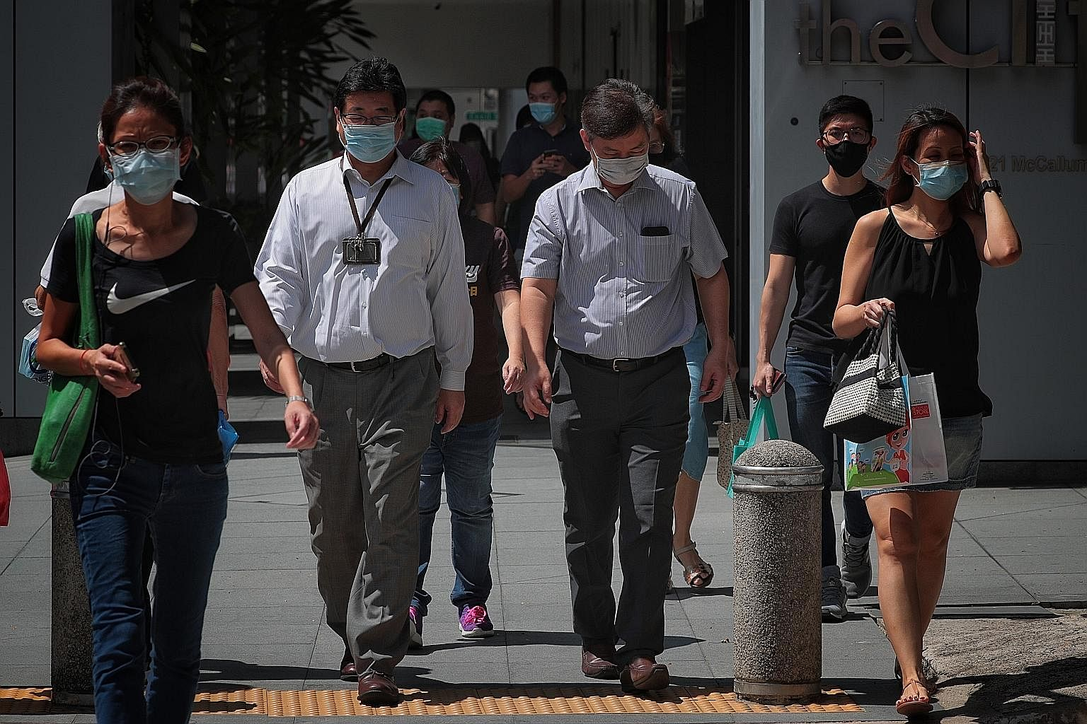 Office workers at Maxwell Food Centre during lunchtime. Office workers in Telok Ayer Street during lunchtime yesterday. According to the Manpower Ministry's guid
