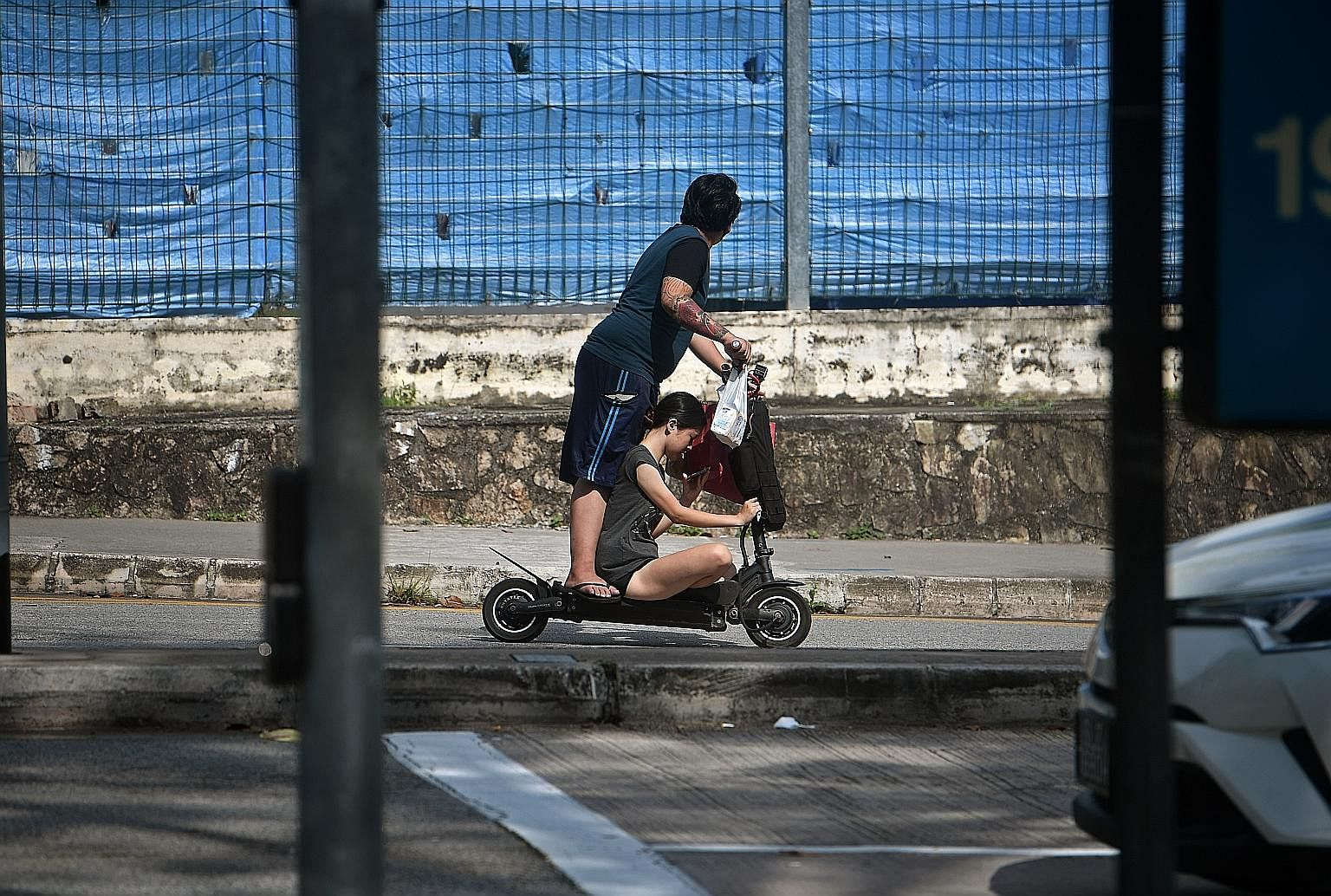A young couple riding a personal mobility device in Toa Payoh in April. The new measures are part of the Government's changes to the Active Mobility Act passed in February to improve safety on the use of devices such as bicycles and electric scooters
