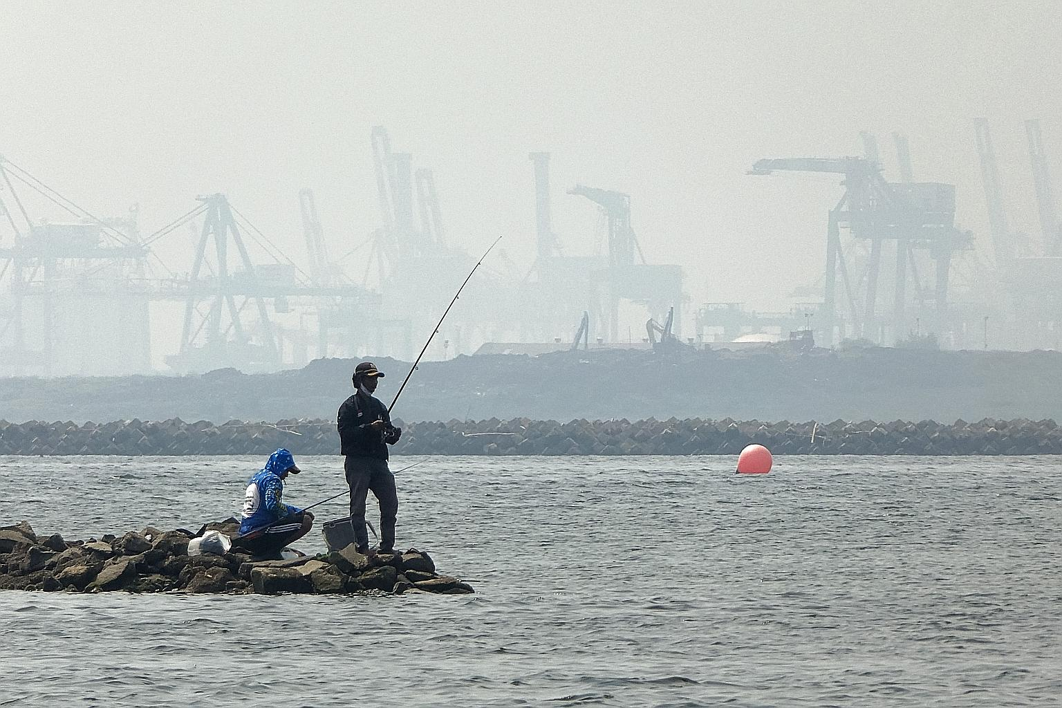 A coastal area of Jakarta shrouded in thick haze last month. If a haze crisis occurs while South-east Asia and the world are still fighting the pandemic, it would compound the strain on public health resources, the writers say, stressing the need to
