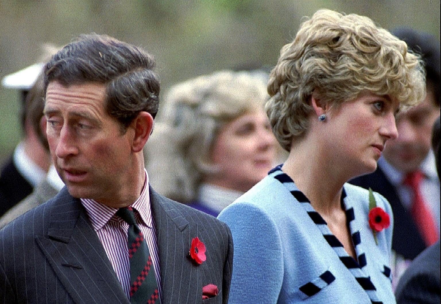 Prince Charles and Princess Diana looking in different directions during a Korean War commemorative service in November 1992.