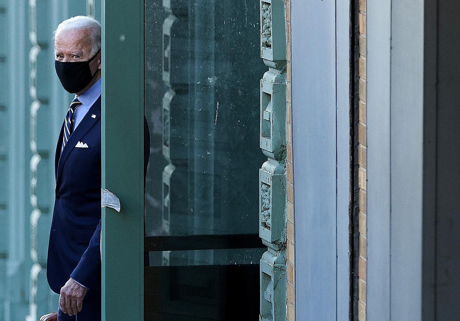 REUTERS Mr Xi Jinping and Mr Joe Biden watching a dragon dance at the International Studies Learning