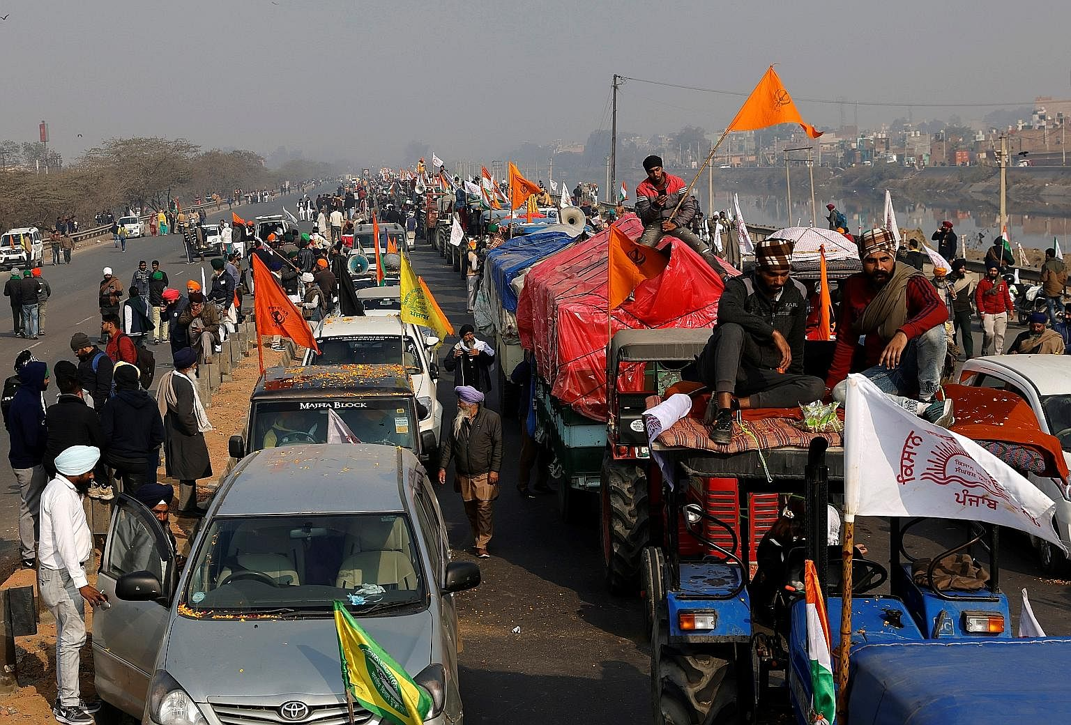 Farmers at a tractor rally in Delhi yesterday - India's Republic Day - to protest against farm laws. One person was reportedly killed in protests, and several police officers were injured.