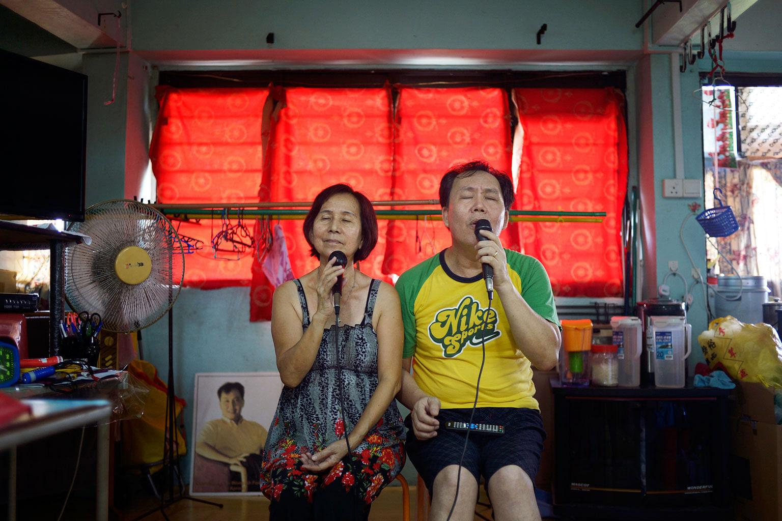 Madam Tian Ying Lee, 62, and her husband Wong Ah Fook, 53. The couple have lived in Dakota Crescent (below) for 21 years and share a love for singing. They have won several singing contests, and often invite their neighbours to join them for karaoke