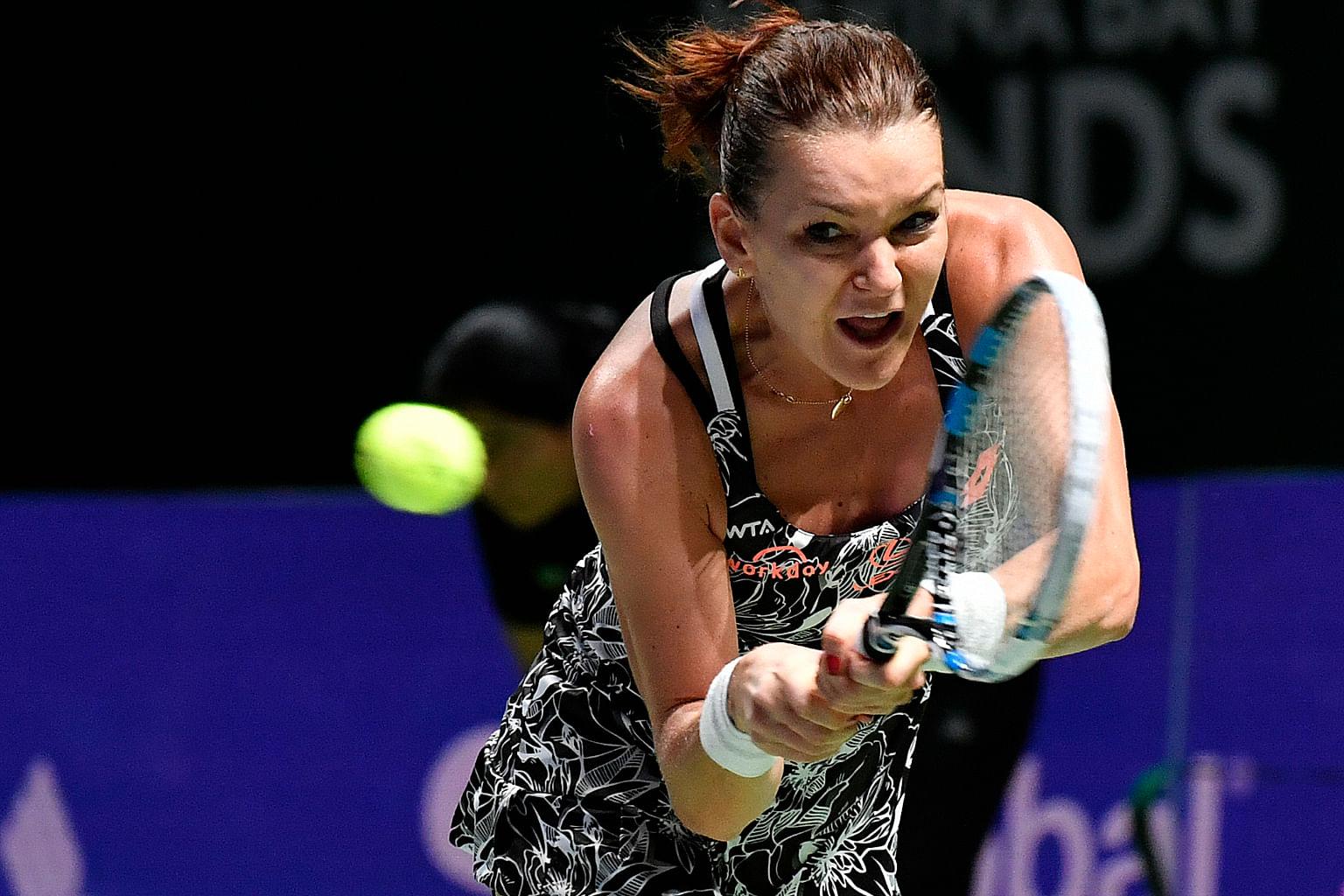 Svetlana Kuznetsova slices a backhand against Agnieszka Radwanska during her 7-5, 1-6, 7-5 victory last night.